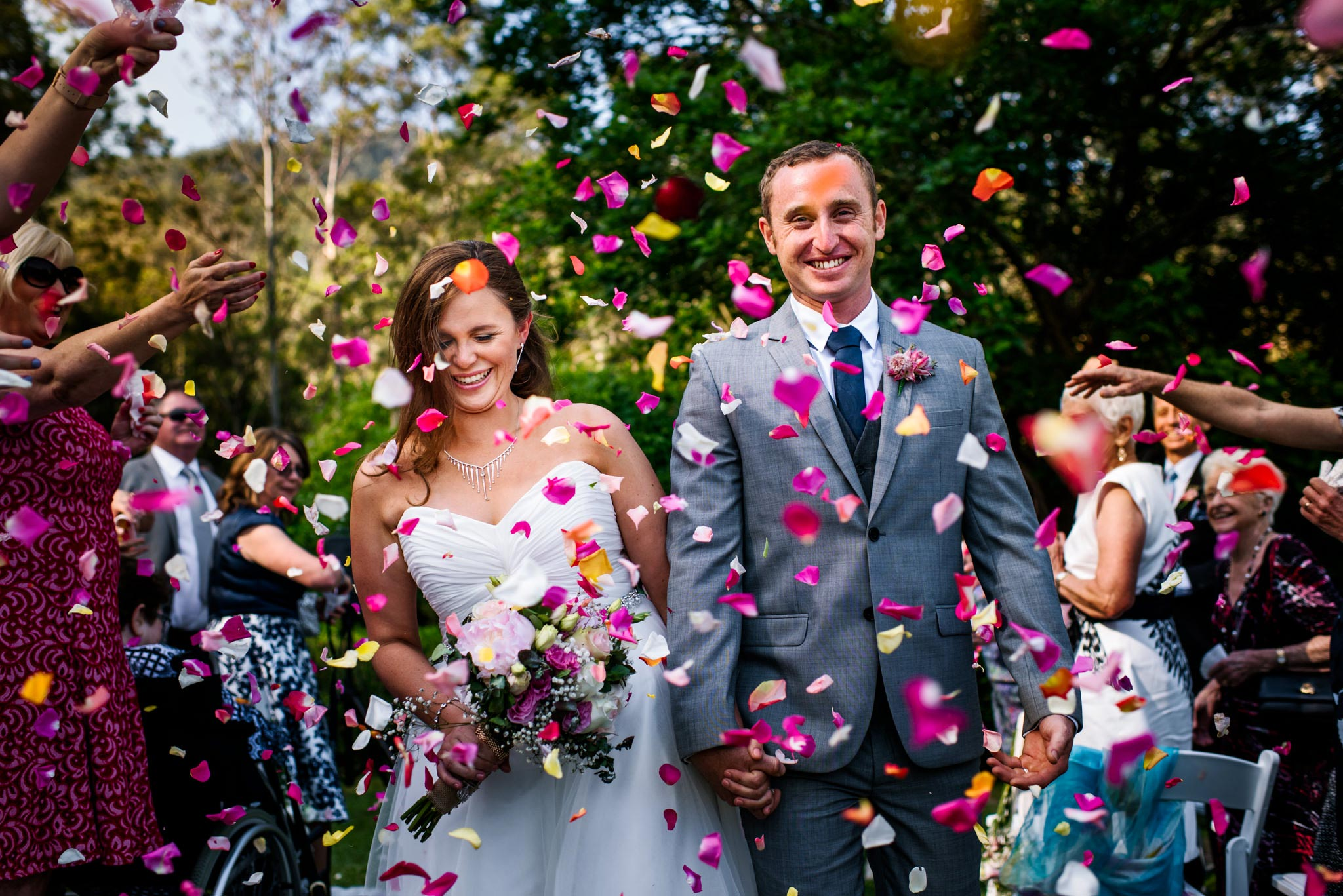 Greenfield Farm wedding recessional with rose petal confetti