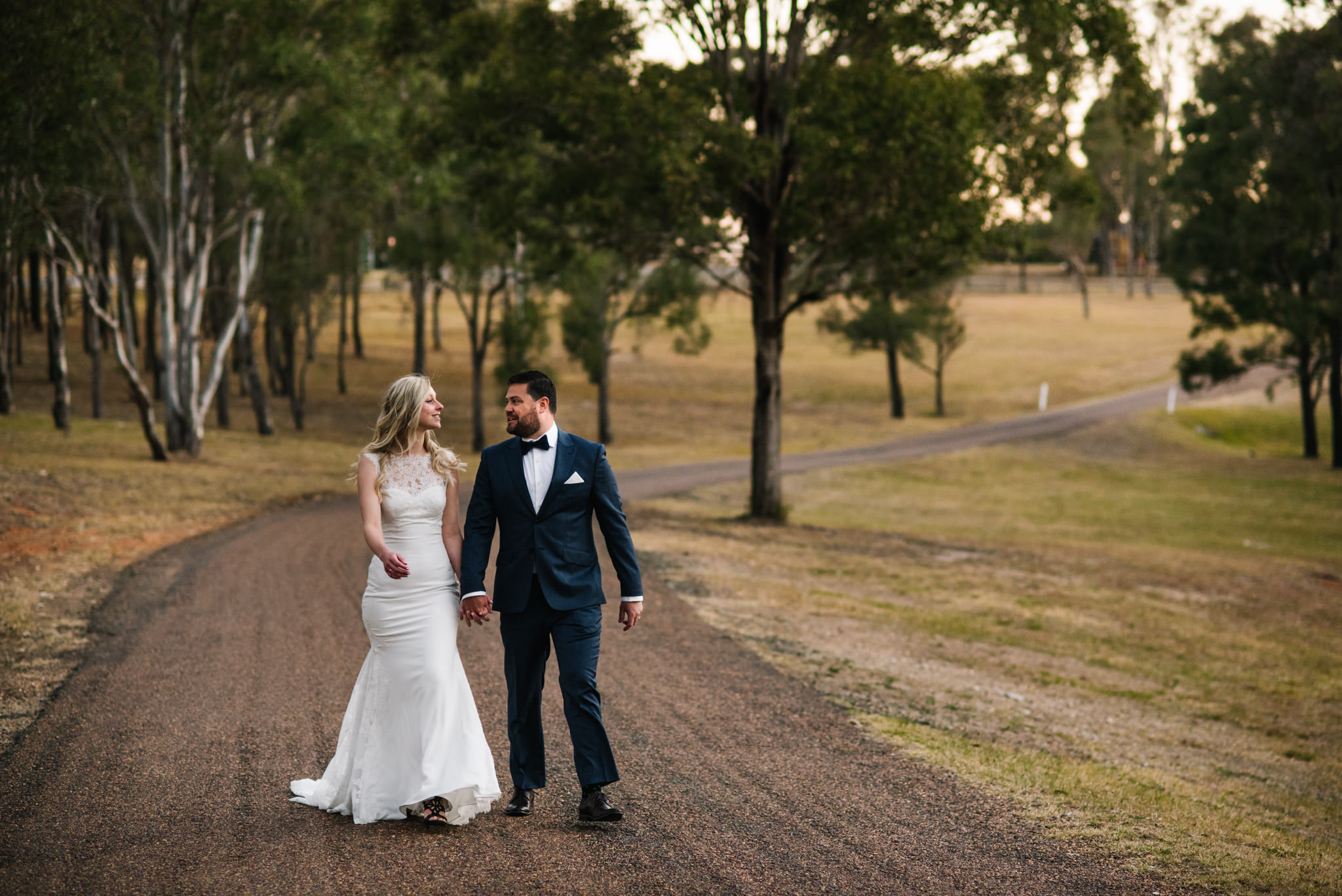 Bride and groom on country road in Hunter Valley