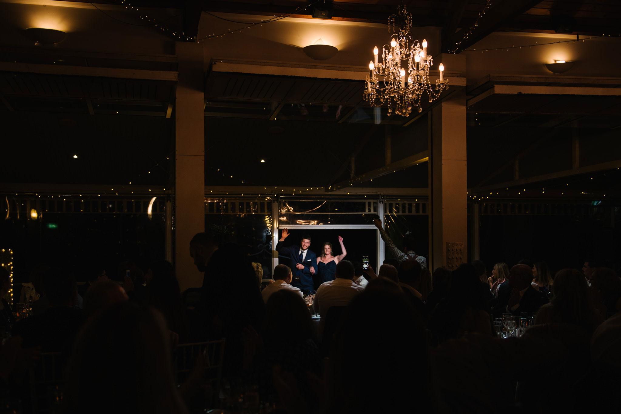 Bridesmaid and groomsman enter wedding reception at Wandin Valley Estate