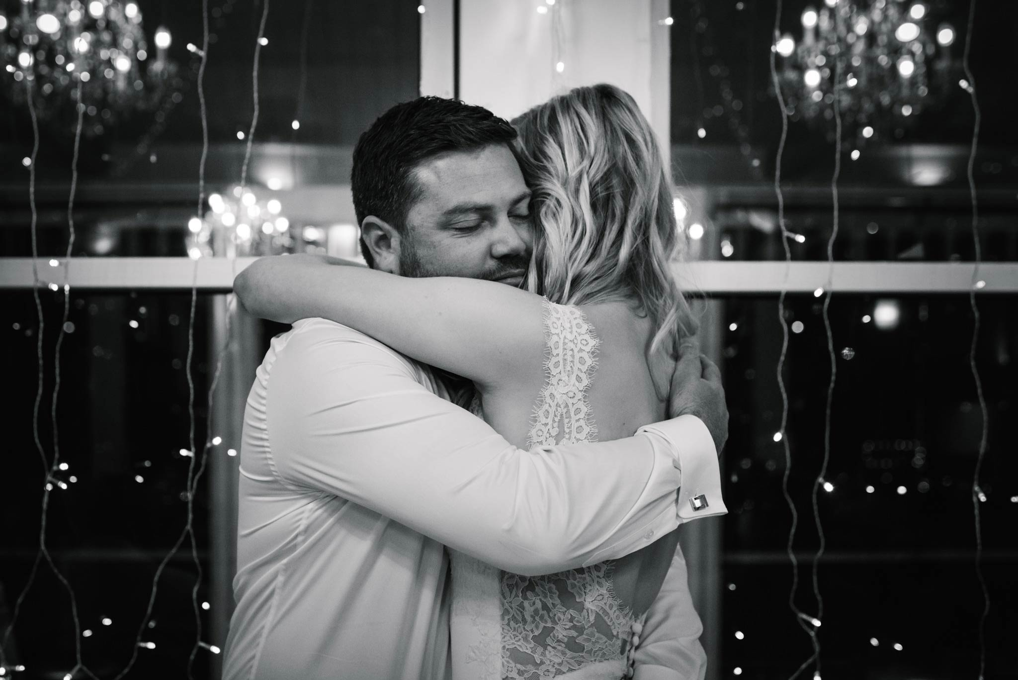 Bride and groom embrace after groom's speech
