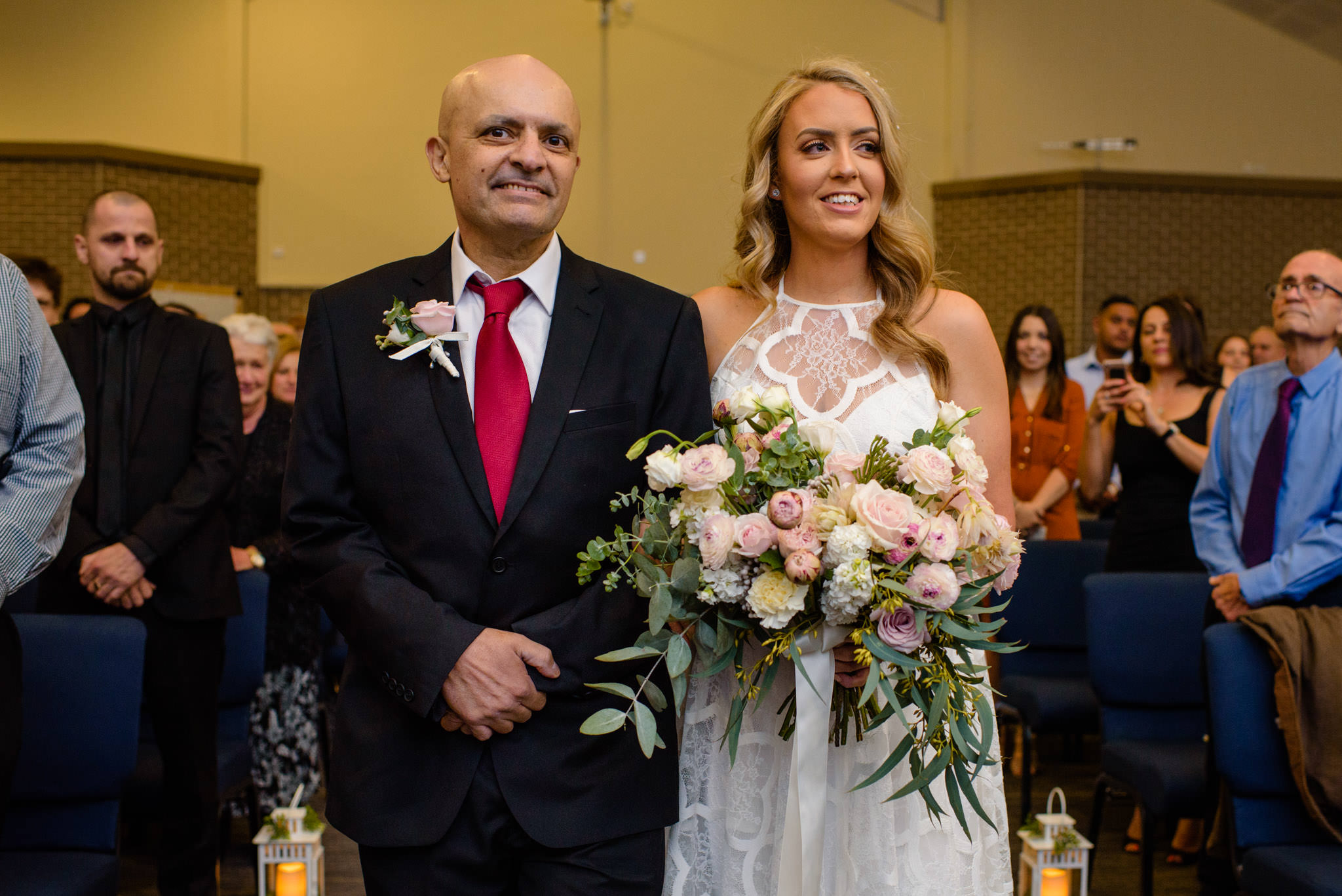 Happy father walks bride down the aisle