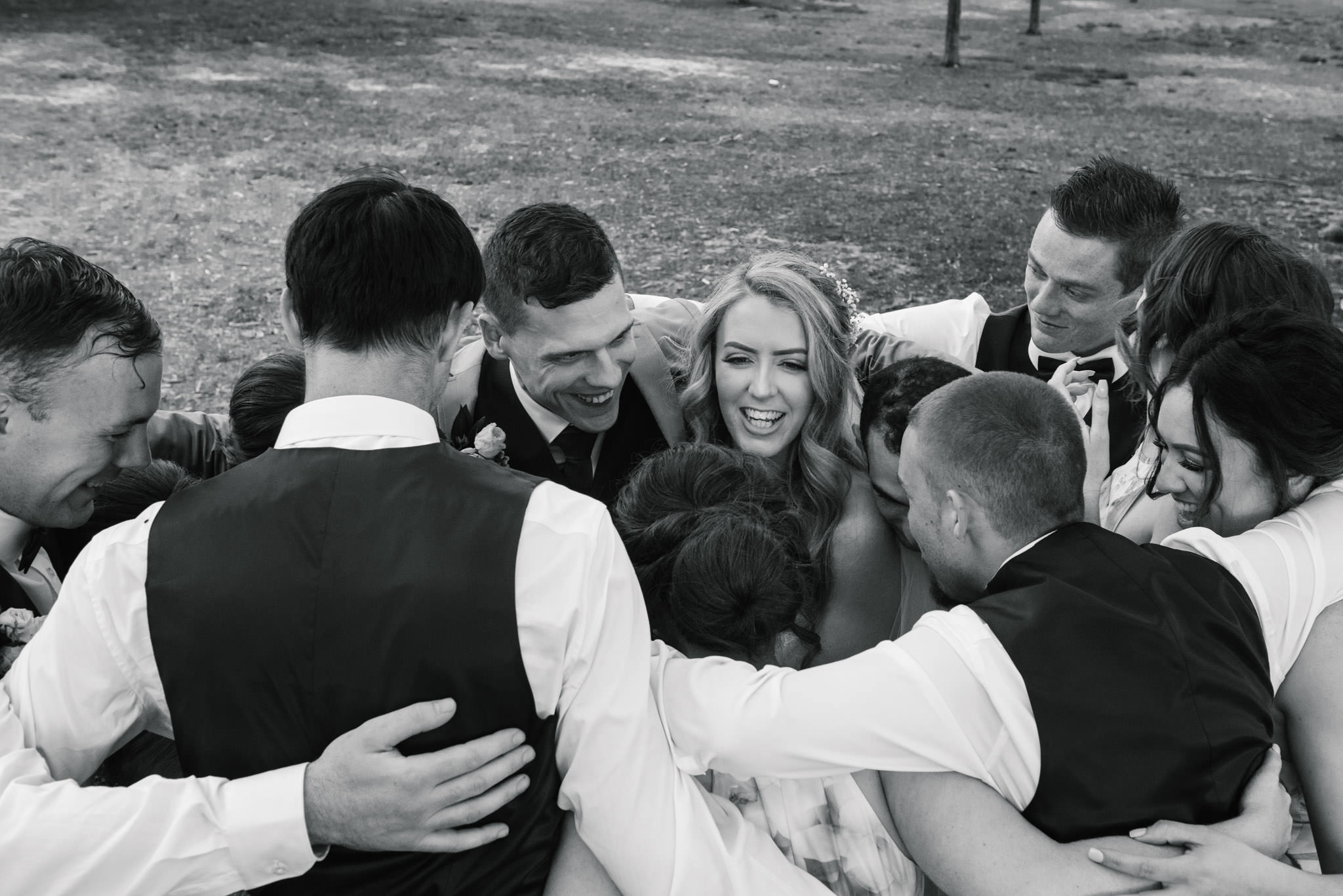 Bridal party gives the newlyweds a group hug
