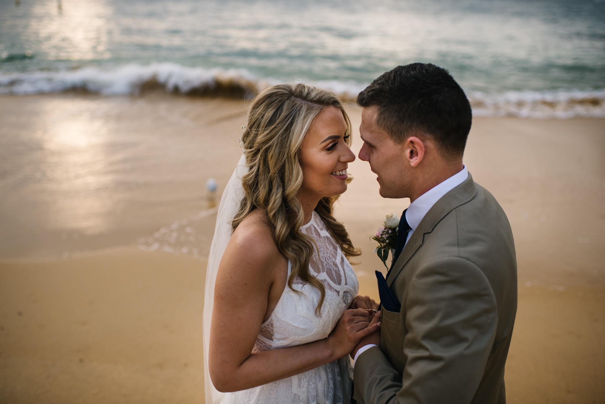 Bride and groom on beach at Camp Cove