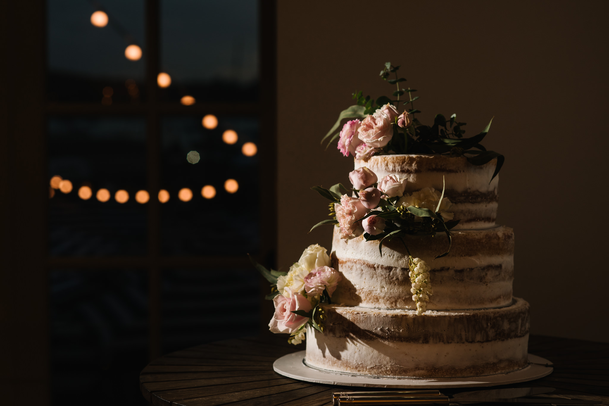 Pretty three tiered cake with floral accents