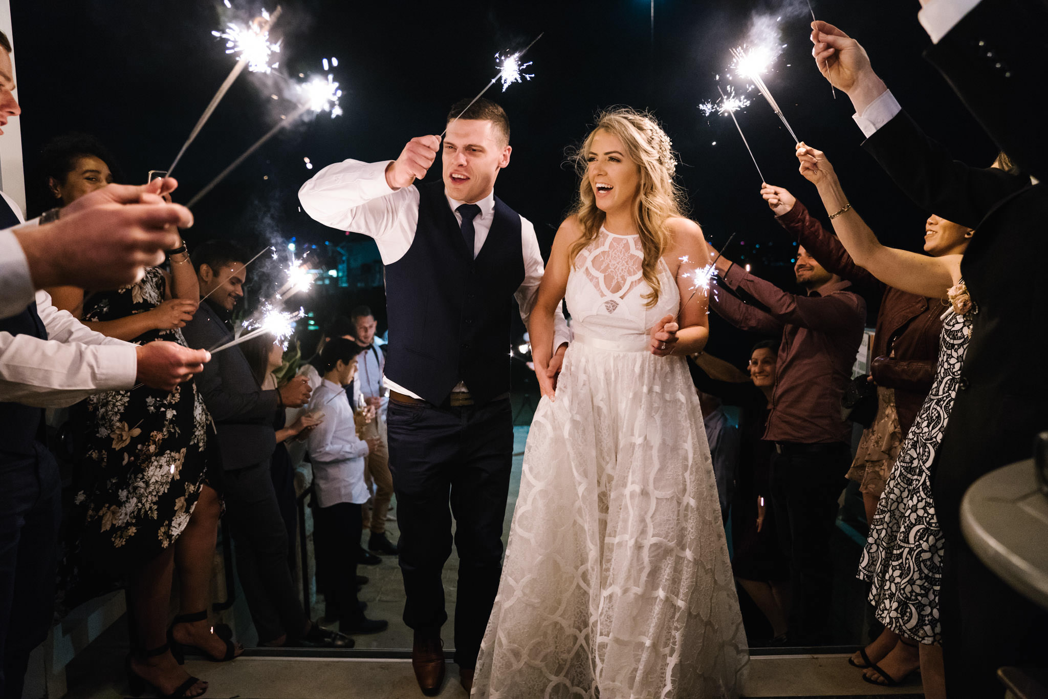Bride and groom laughing during sparkler exit