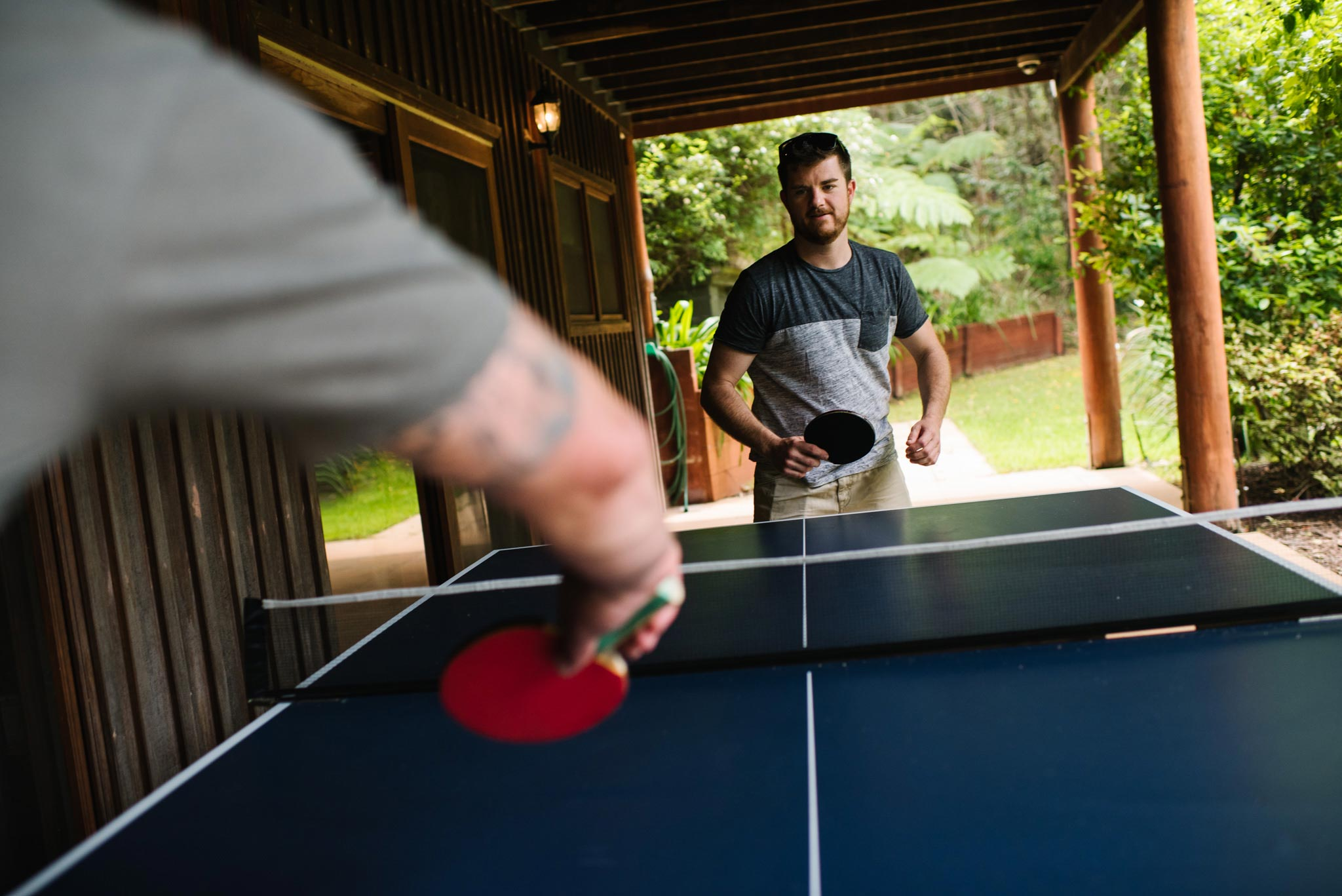 Groom playing table tennis before wedding