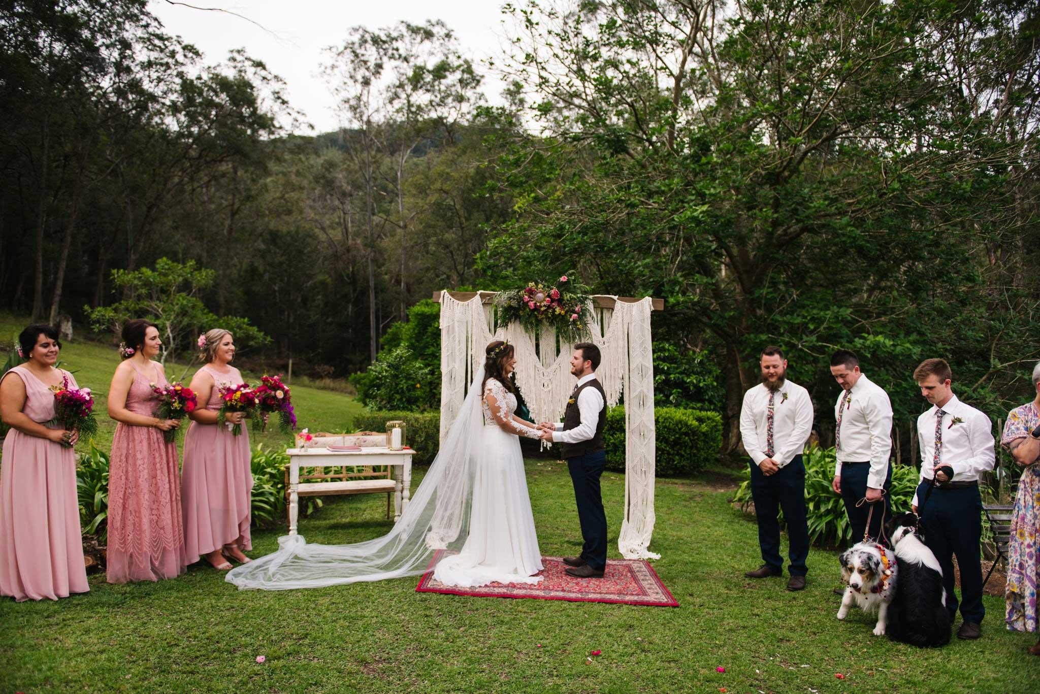 Rustic wedding ceremony with macrame altar