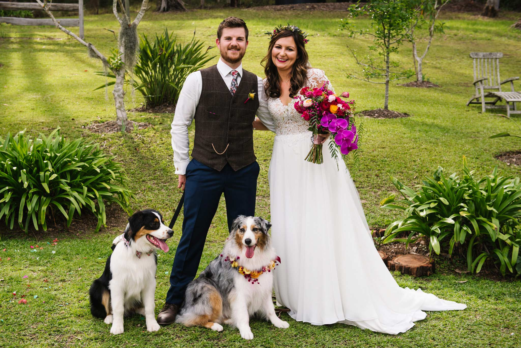 Two dogs with floral wreaths act as ring bearers
