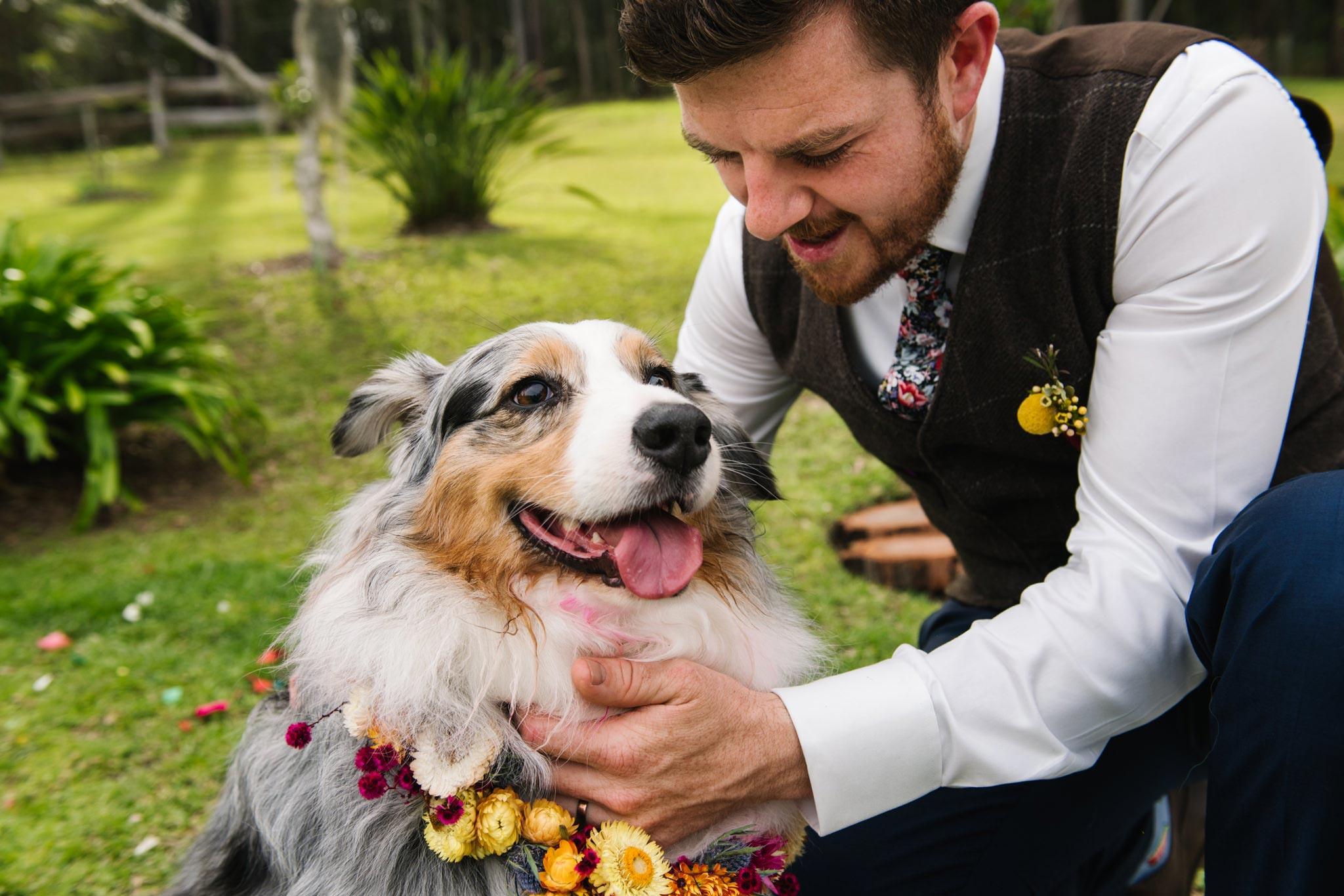 Groom hugging his dog