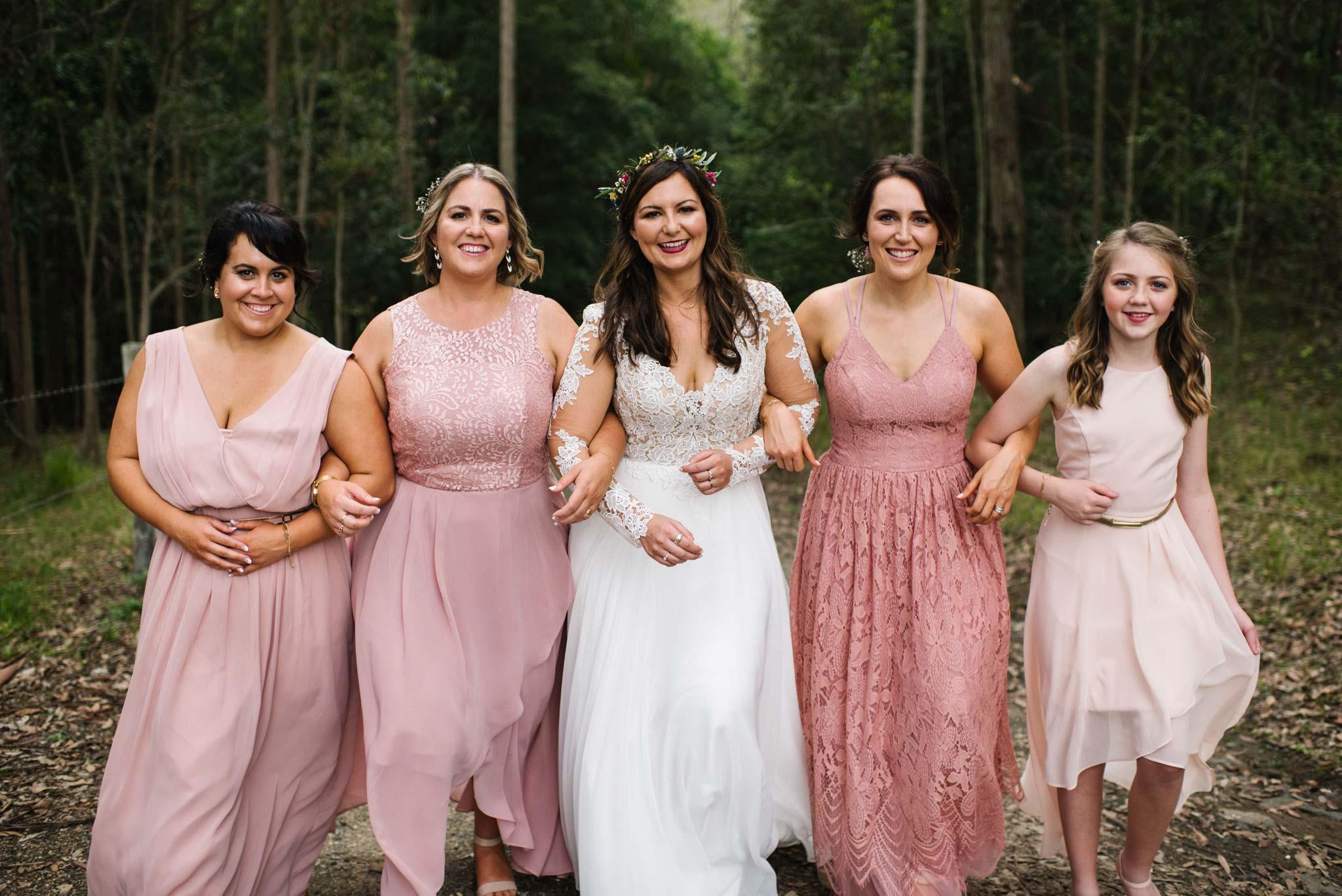 Bride and bridesmaids in various shades of pink