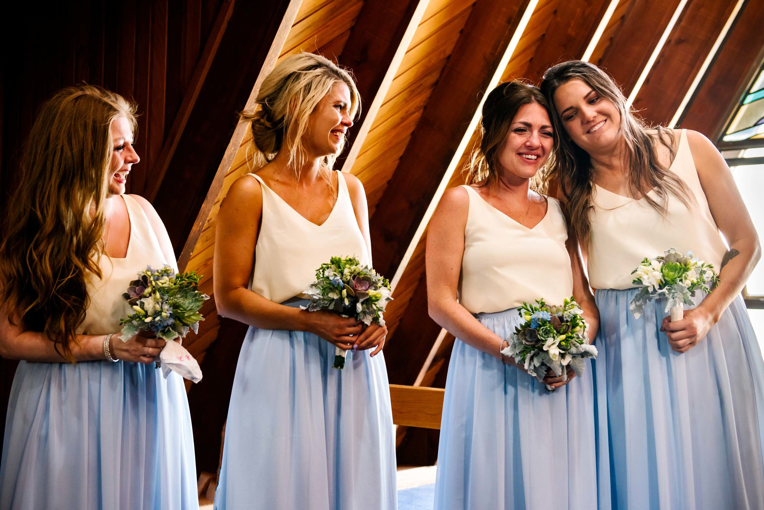 Bridesmaids looking emotional during wedding ceremony