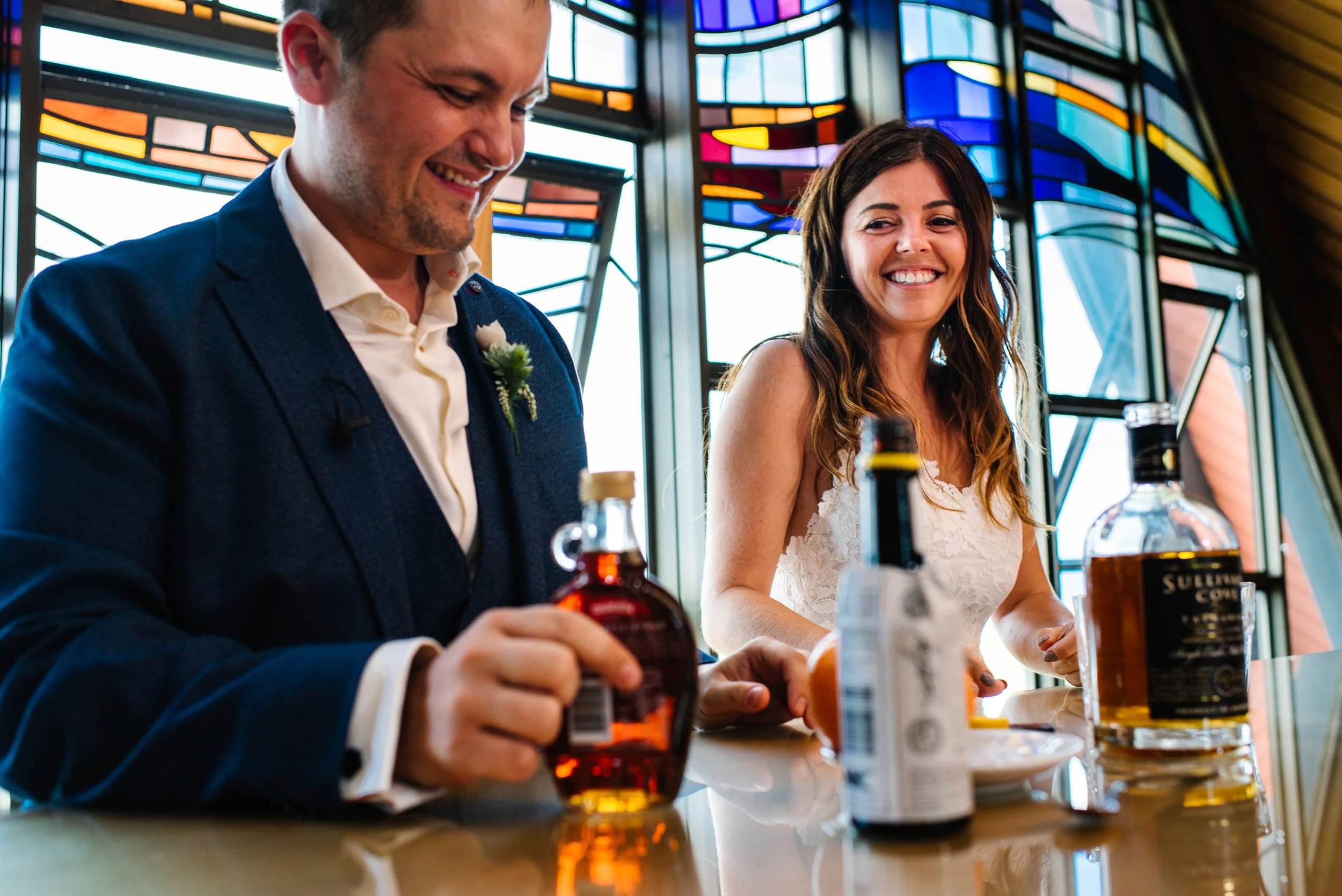 Bride and groom prepare an Old Fashioned during wedding service