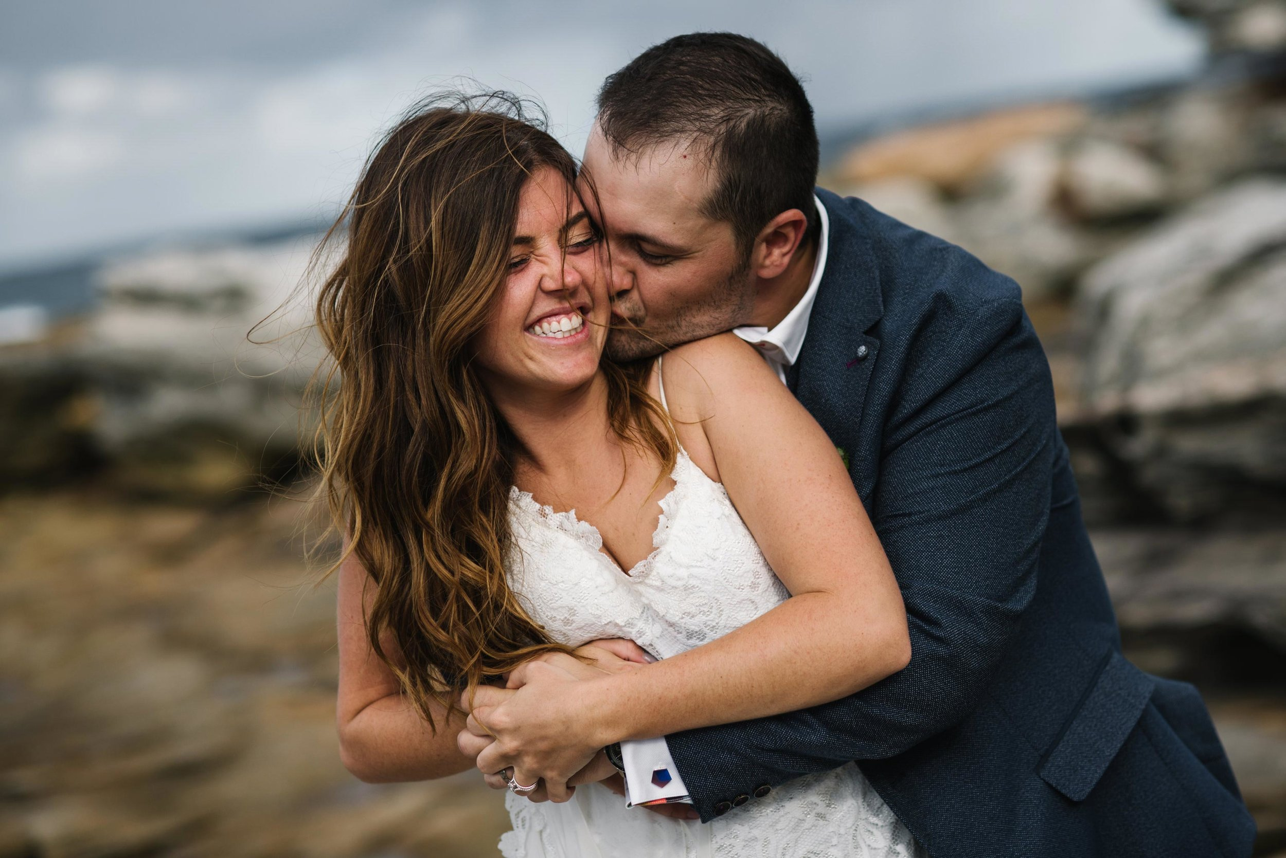 Bride and groom cuddling and smiling