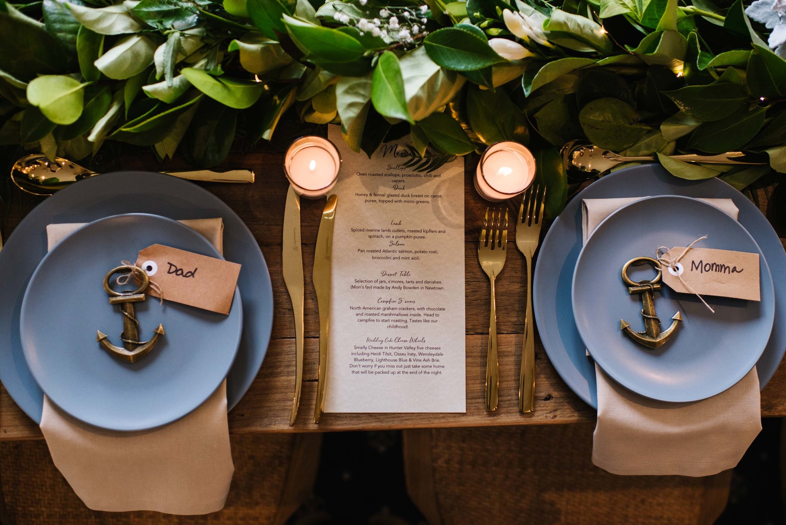 Place-setting at beach themed reception, with anchor name tags