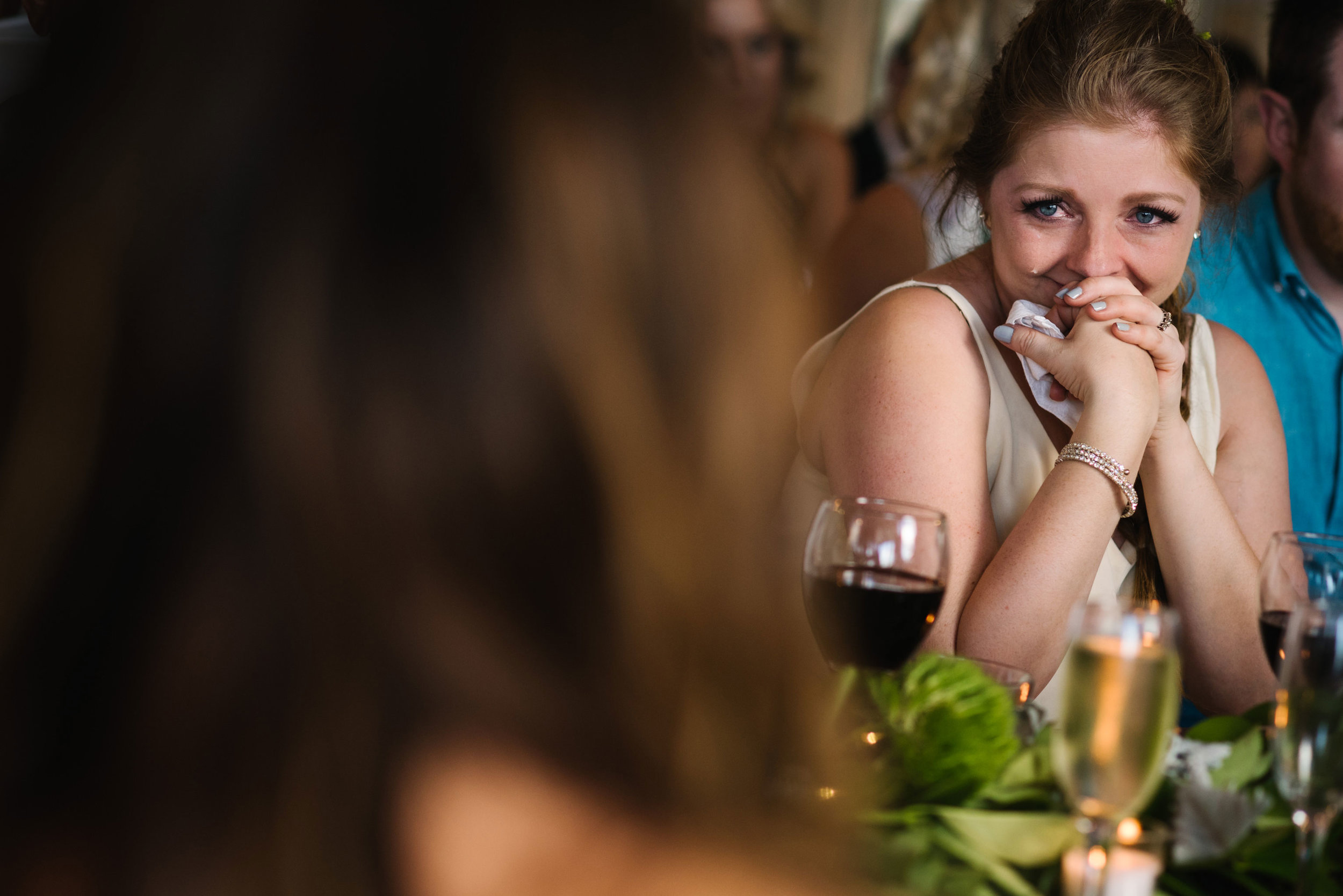 Bridesmaid crying during heartfelt speeches