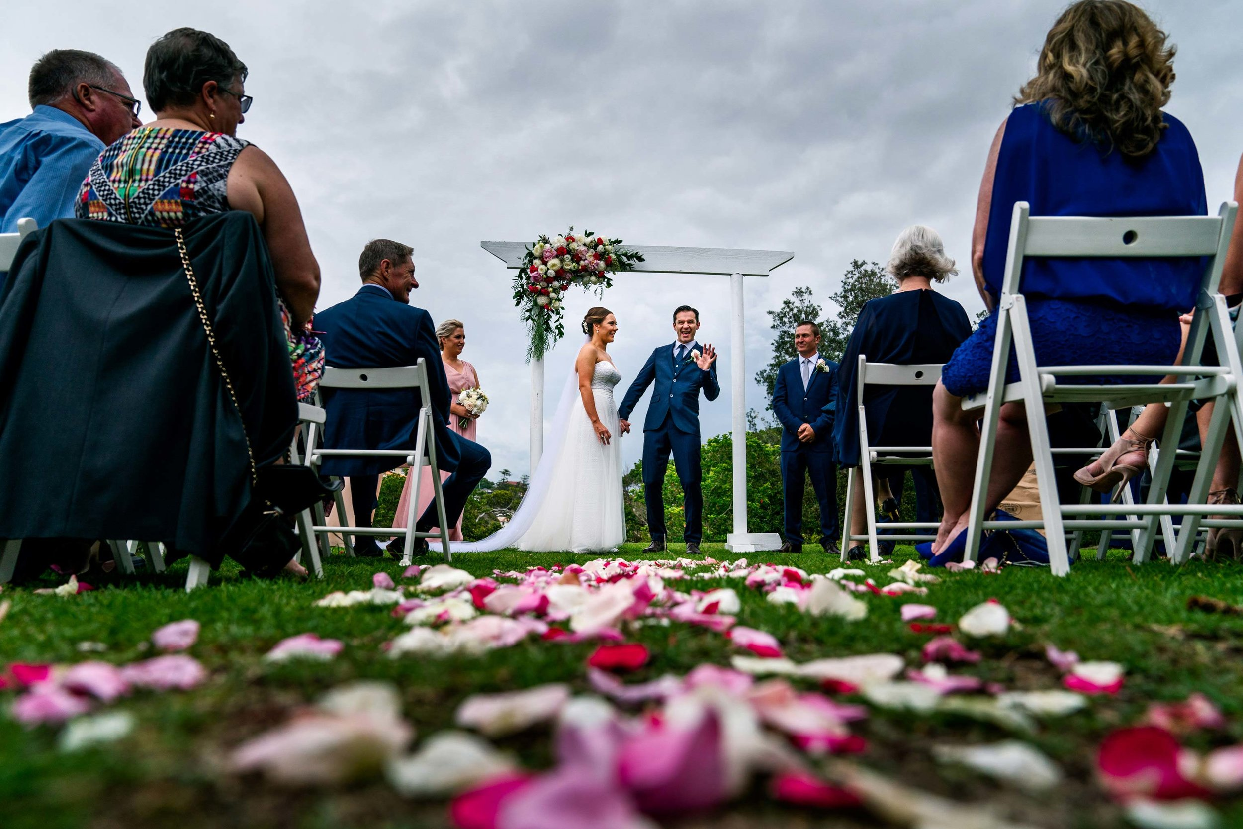 Wedding ceremony in park above Shelly Beach with altar and colourful flowers