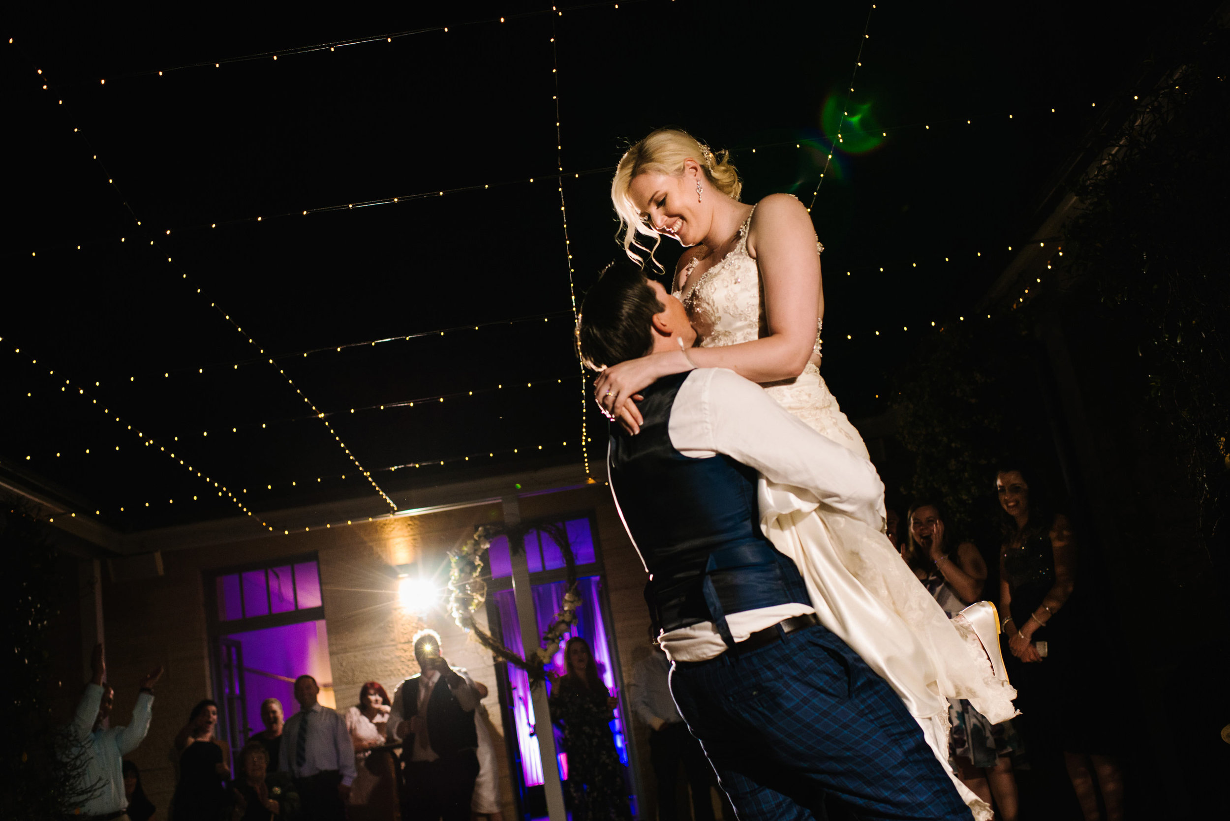 Groom lifts bride during first dance at Gunner's Barracks wedding reception