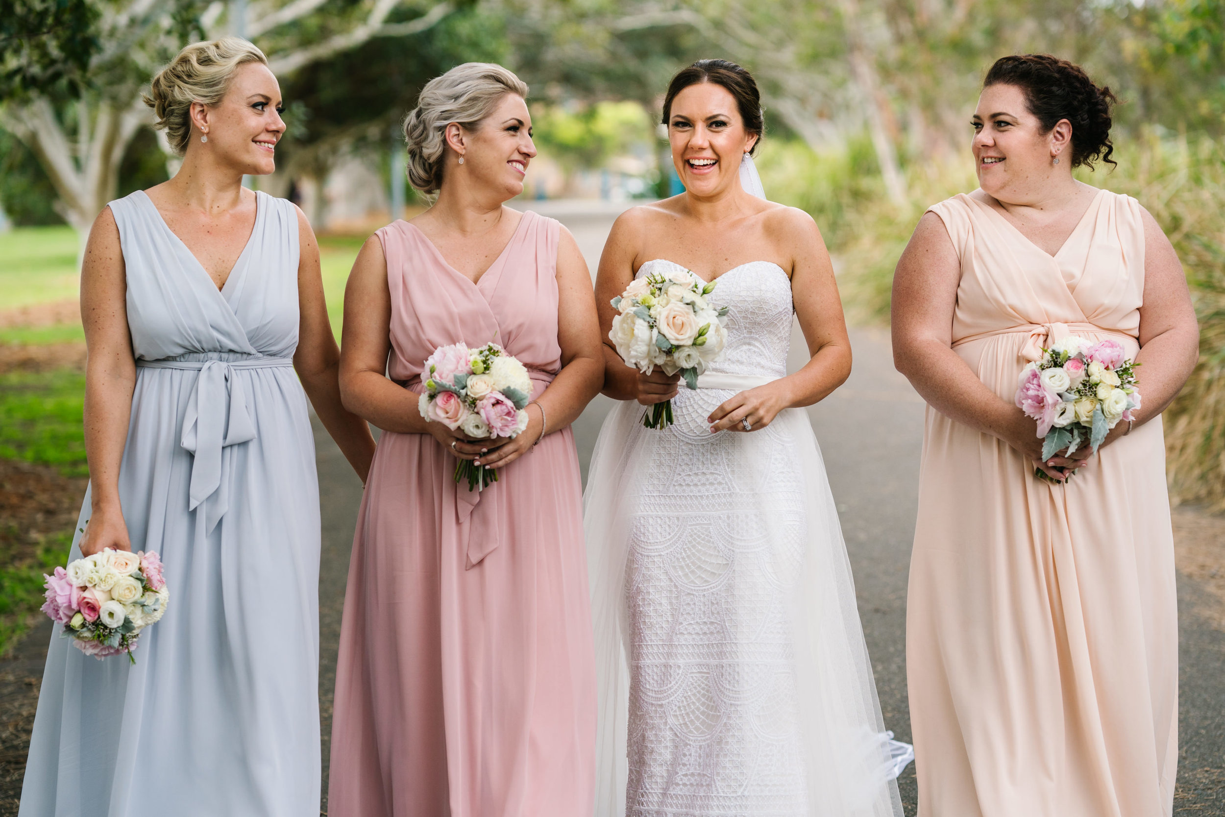 Bridesmaids in multicolour beach gowns