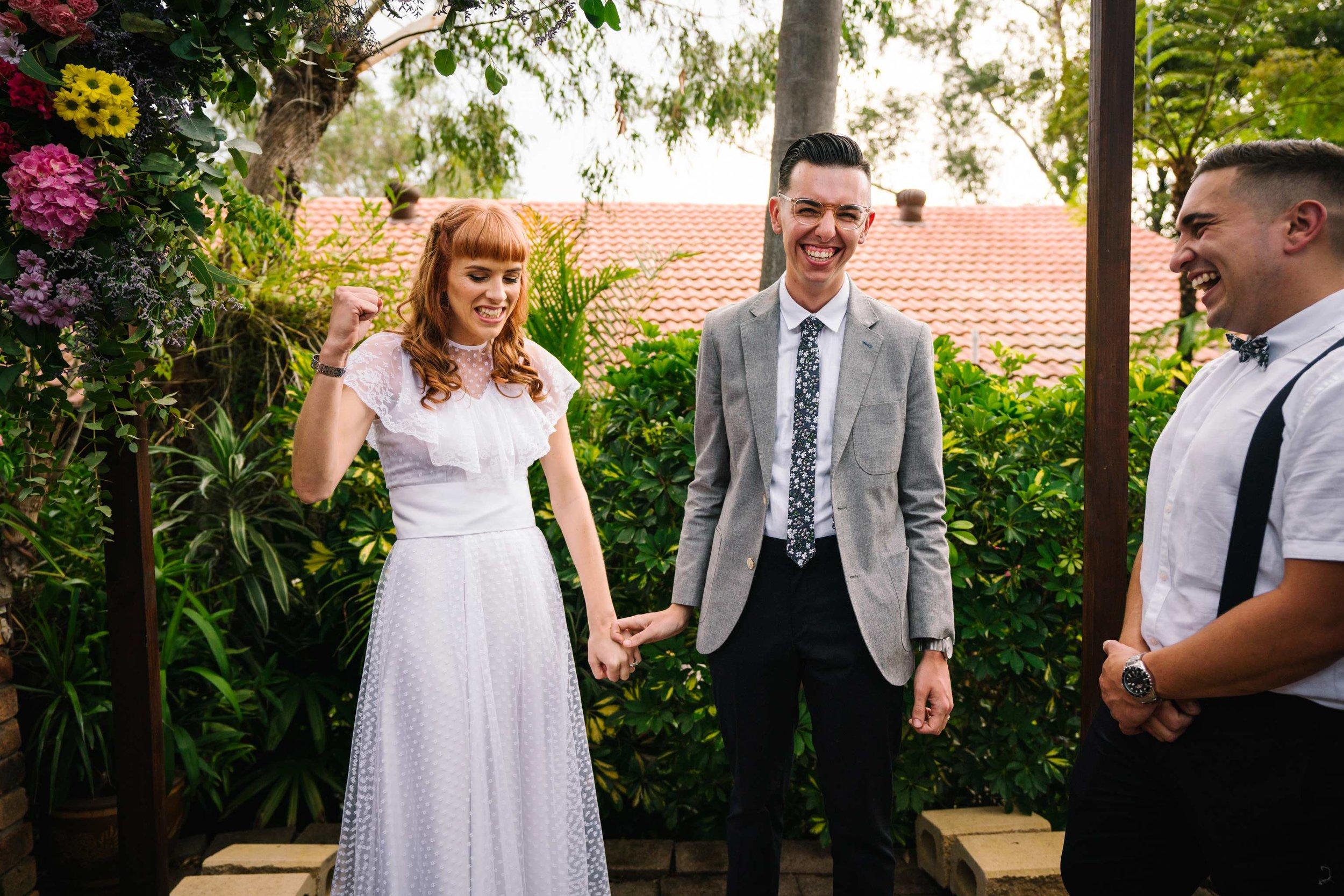 bride and groom celebrate after garden wedding service