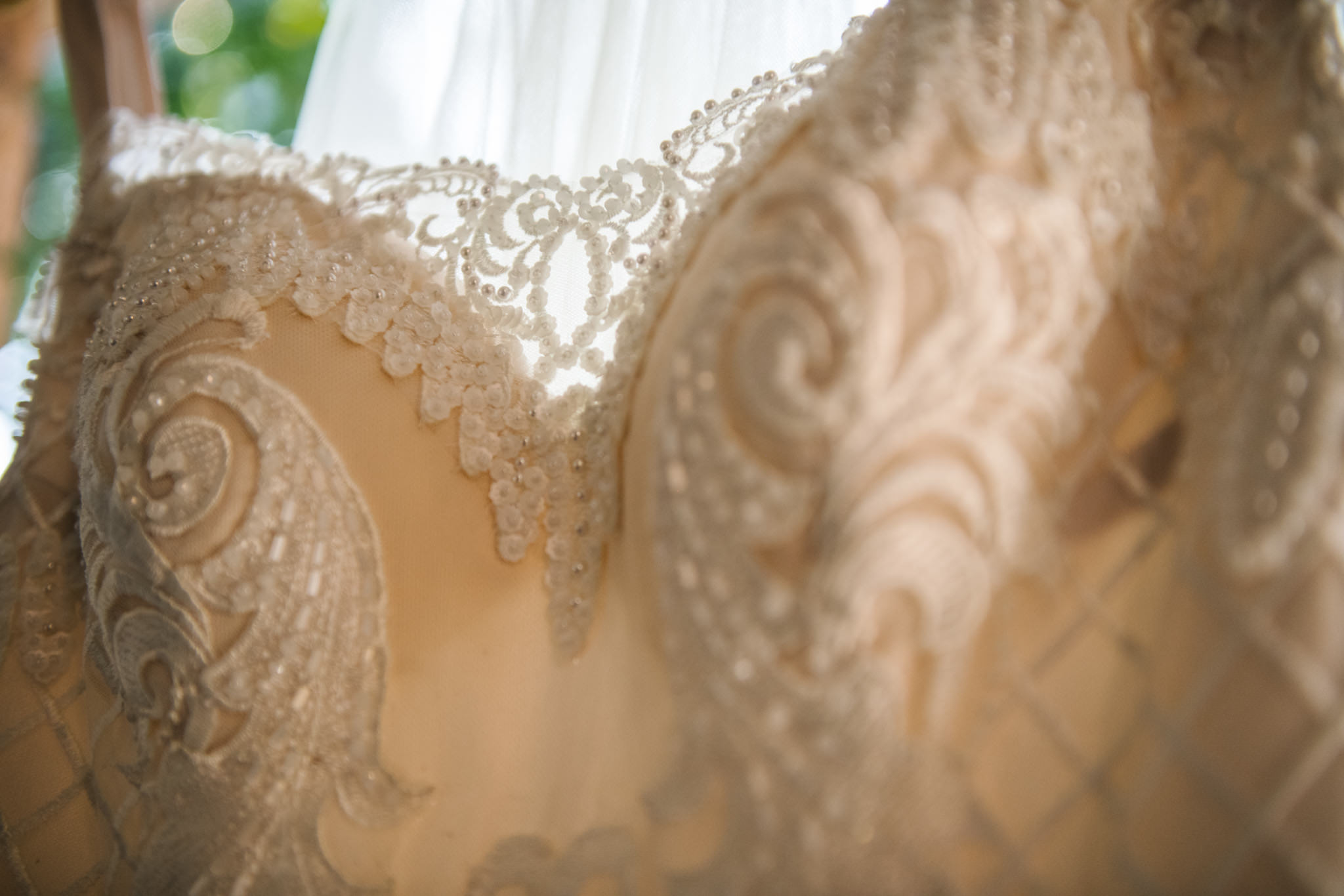 Detail of lace and beaded wedding gown