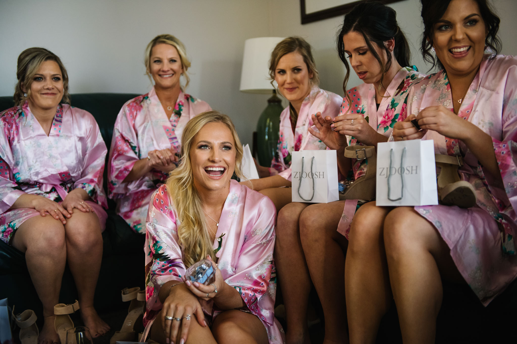 Bridesmaids opening gifts and laughing