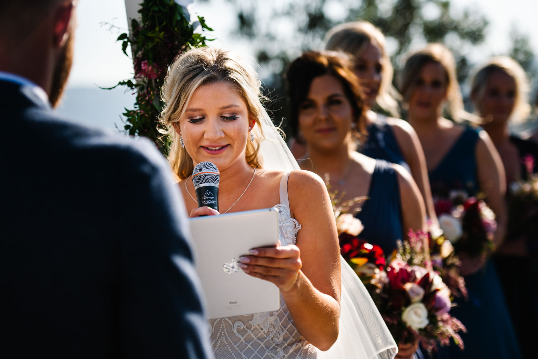 Bride crying as she reads her vows to her new husband