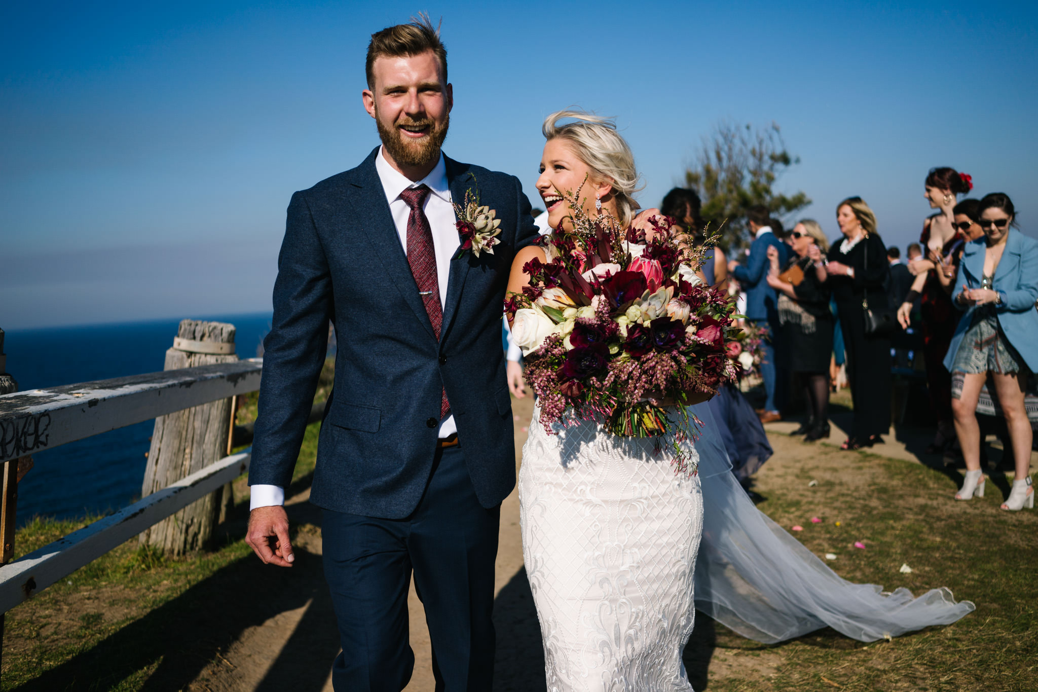 Newlyweds smiling after Northern Beaches wedding ceremony