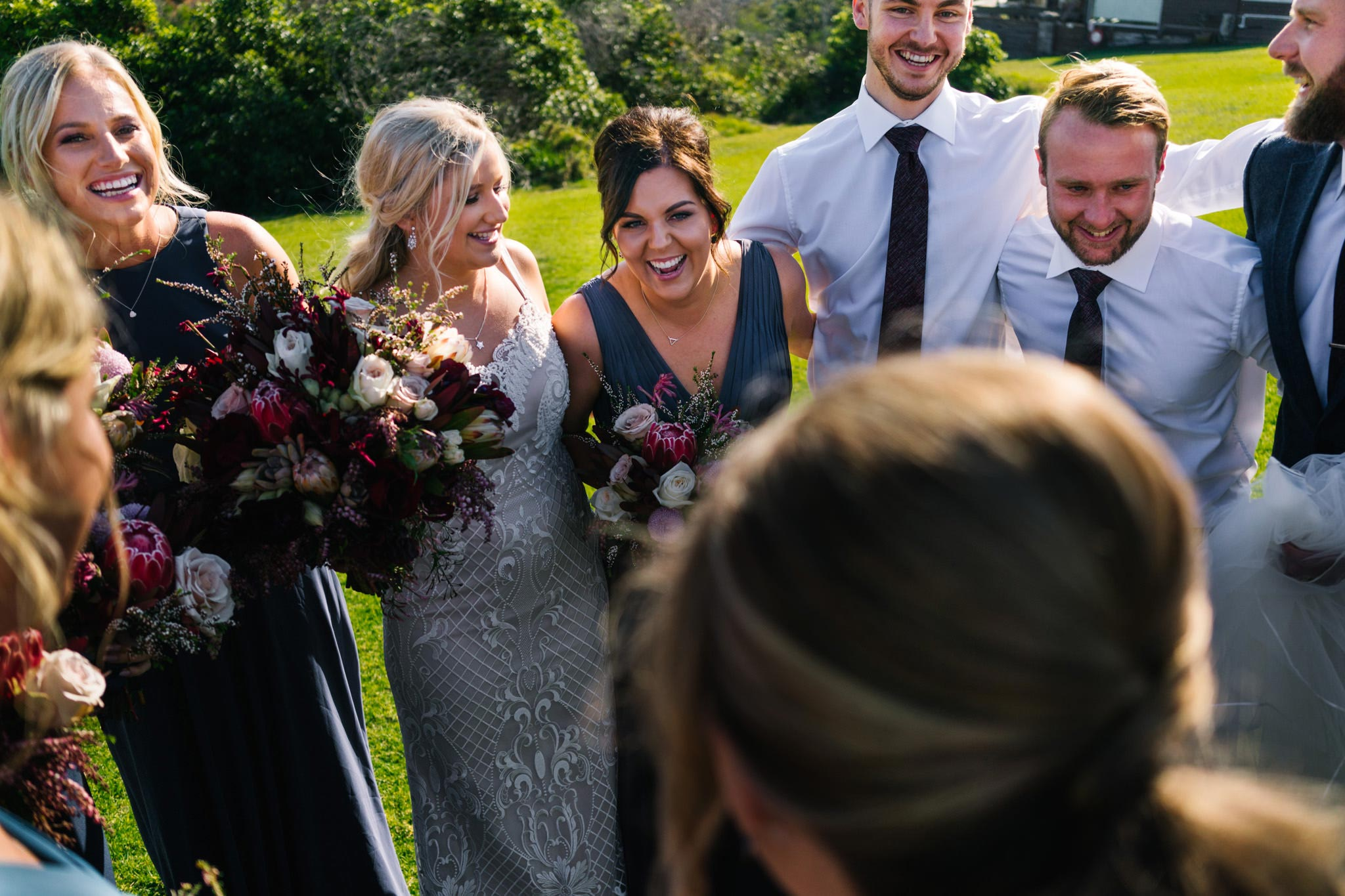 Bridal party embracing and smiling after ceremony