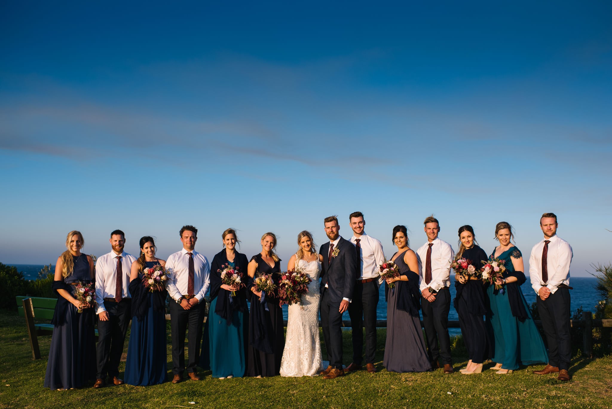 Large bridal party on lookout over Turimetta beach