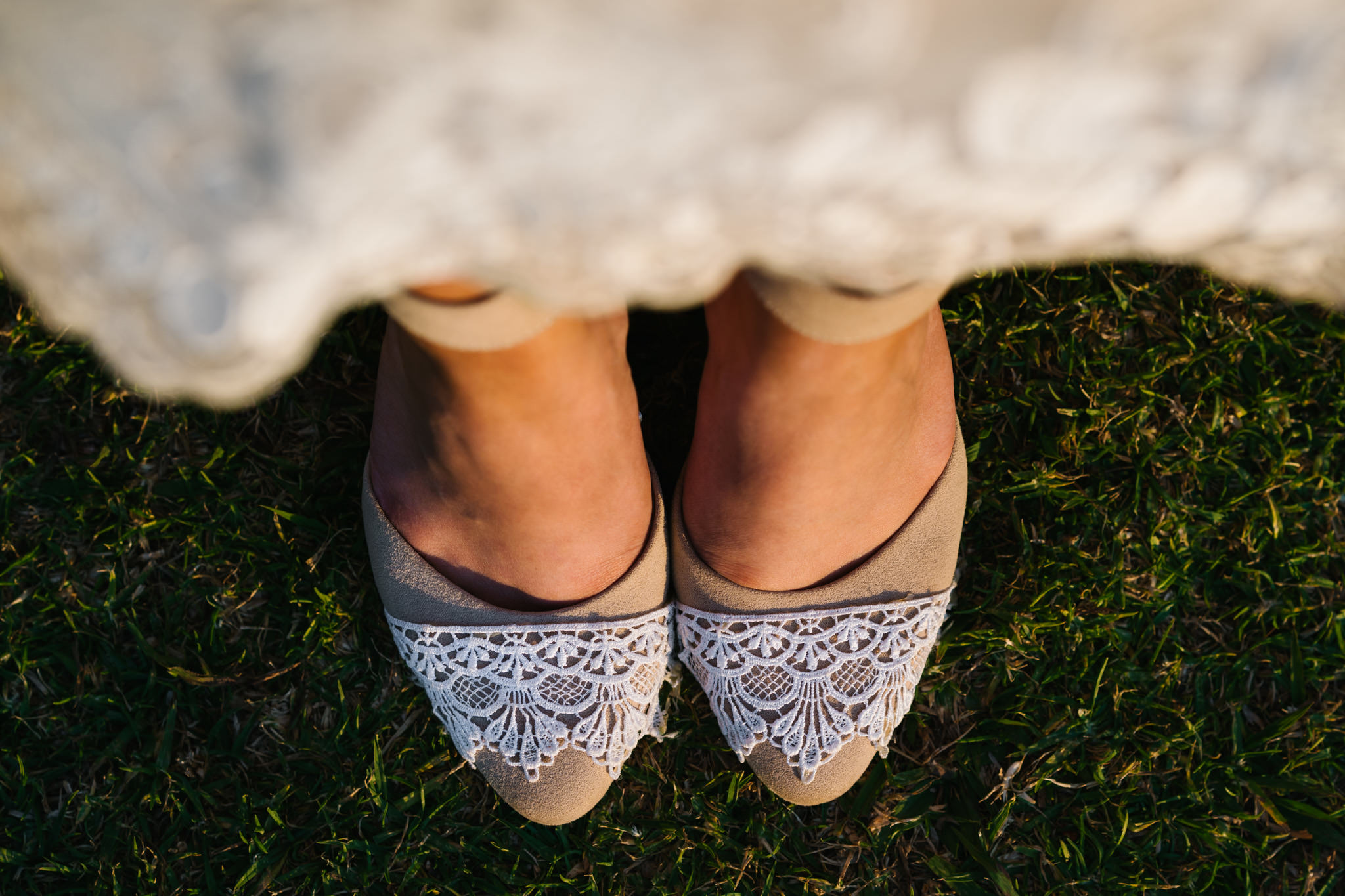 Detail of lace on the bride's beige shoes