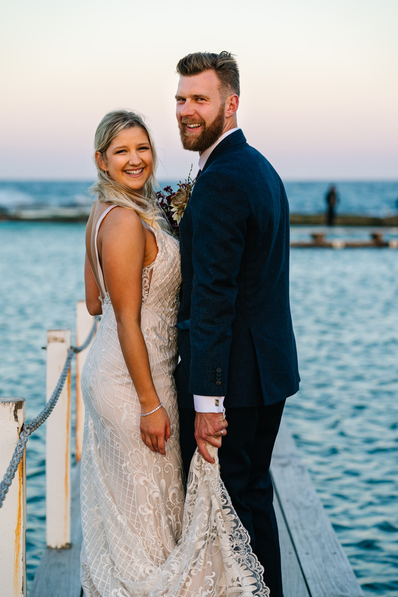 Bride and groom smiling at Narrabeen pool