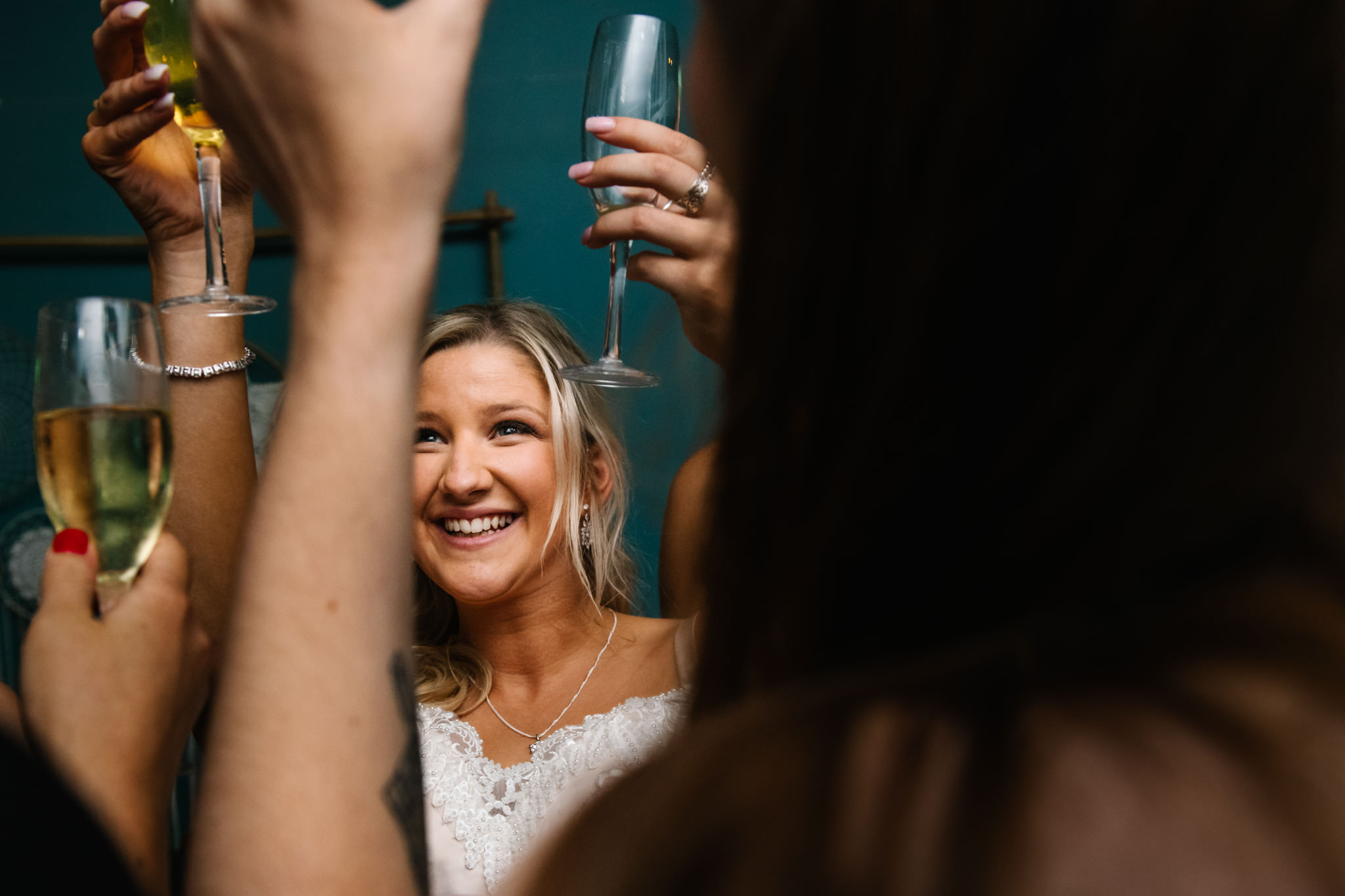 Bride doing a cheers with her guests