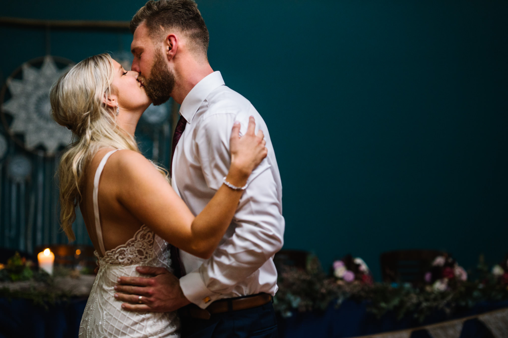 Newlyweds kiss during their first dance at Narrabeen Beach SLSC reception