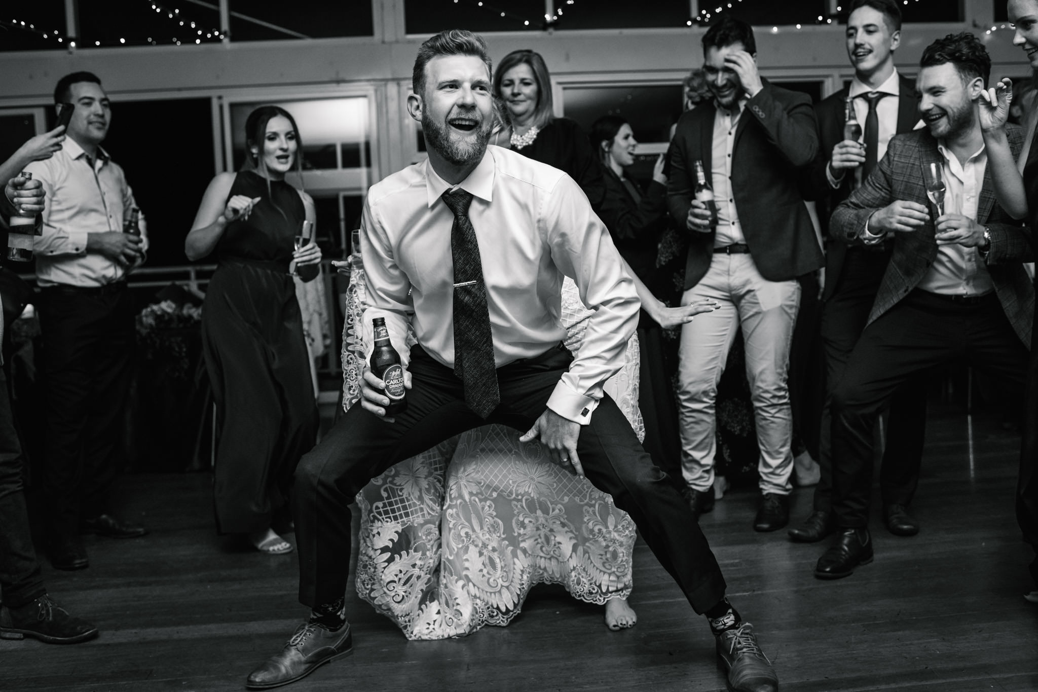 Groom dirty dancing with bride at Narrabeen Beach SLSC
