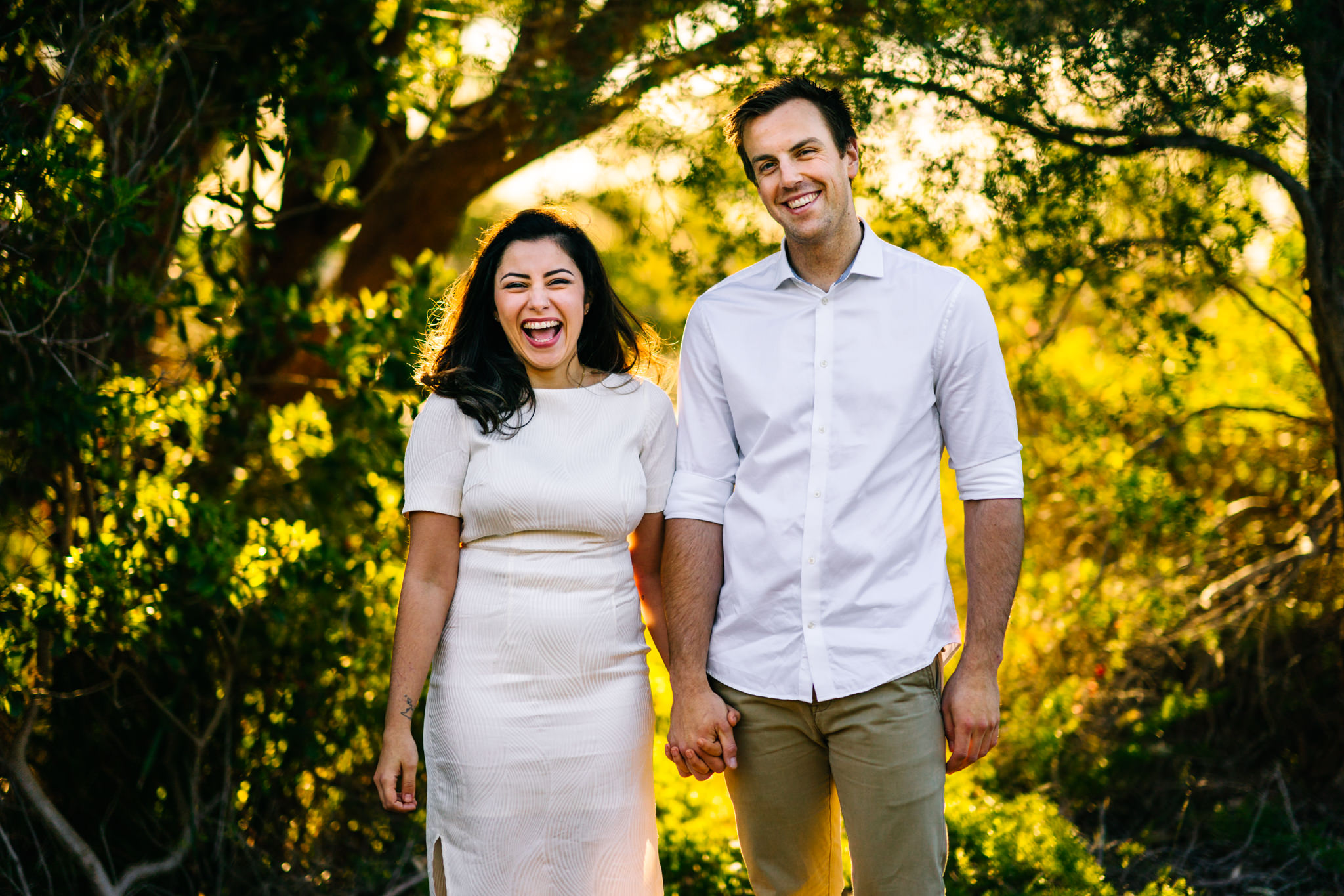 Bride to be laughs during engagement session