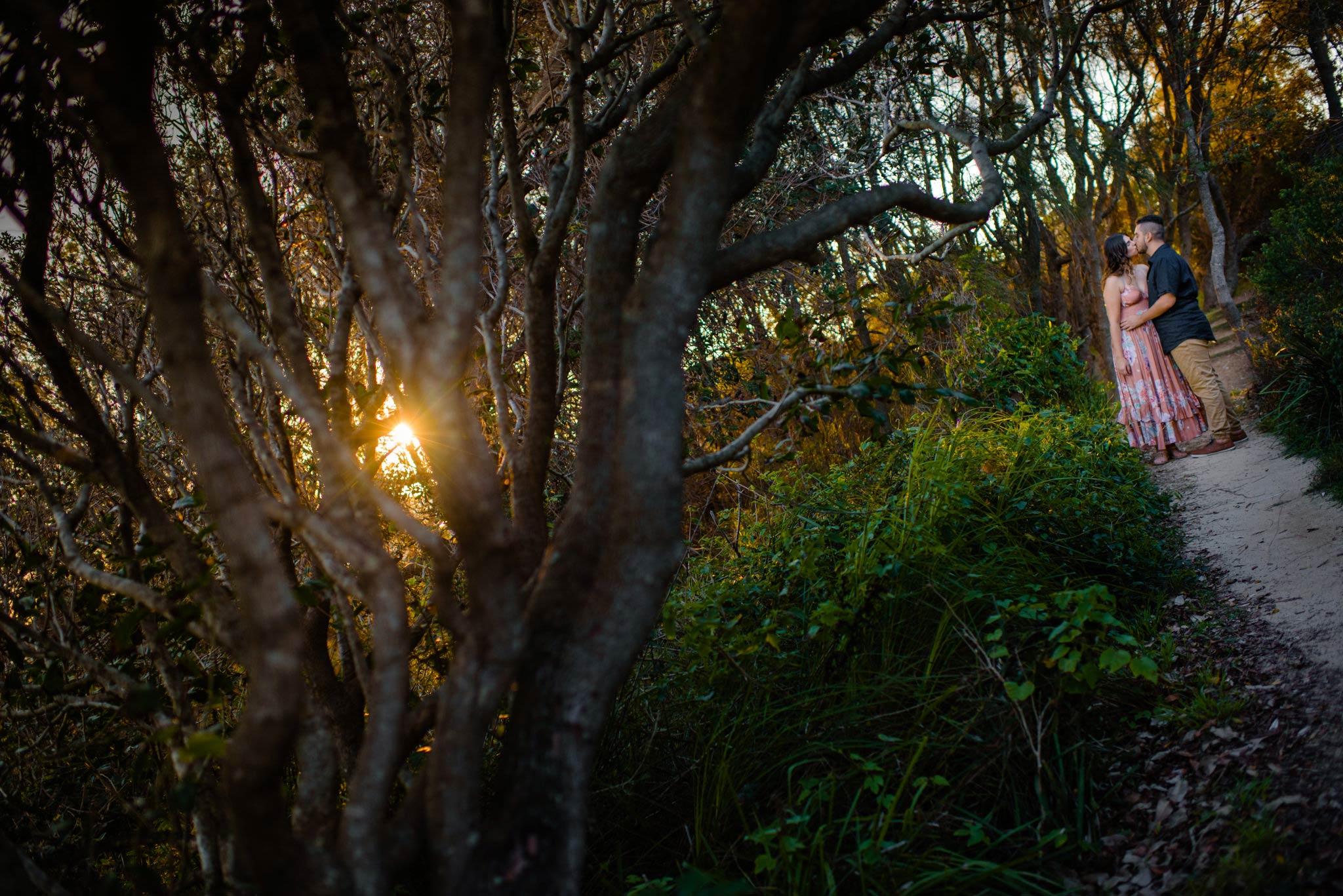 Engaged couple in woods near Turimetta Beach