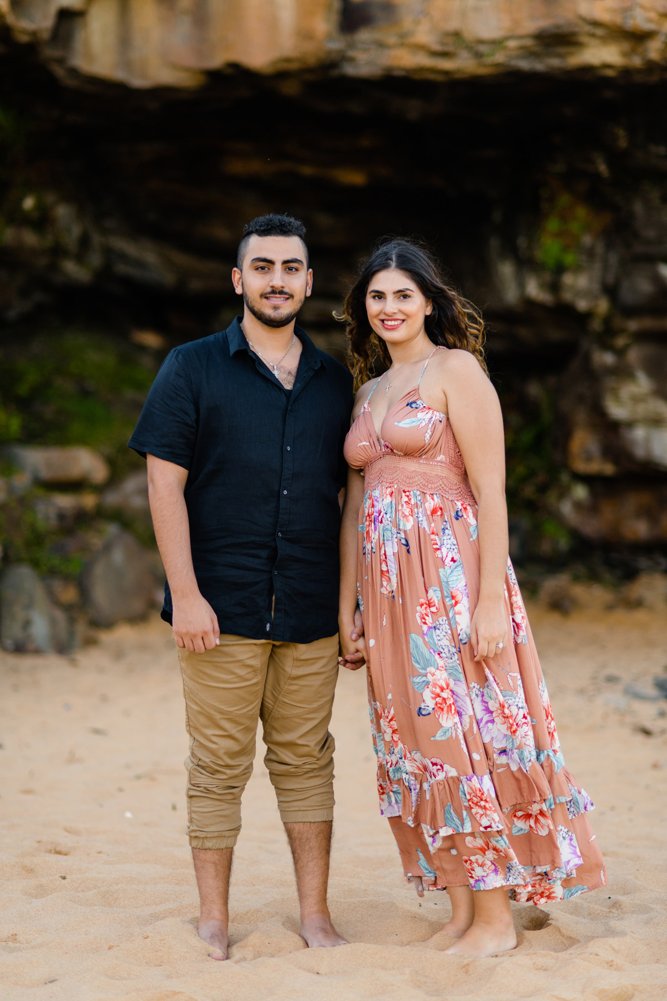 Newly engaged couple on Turimetta Beach