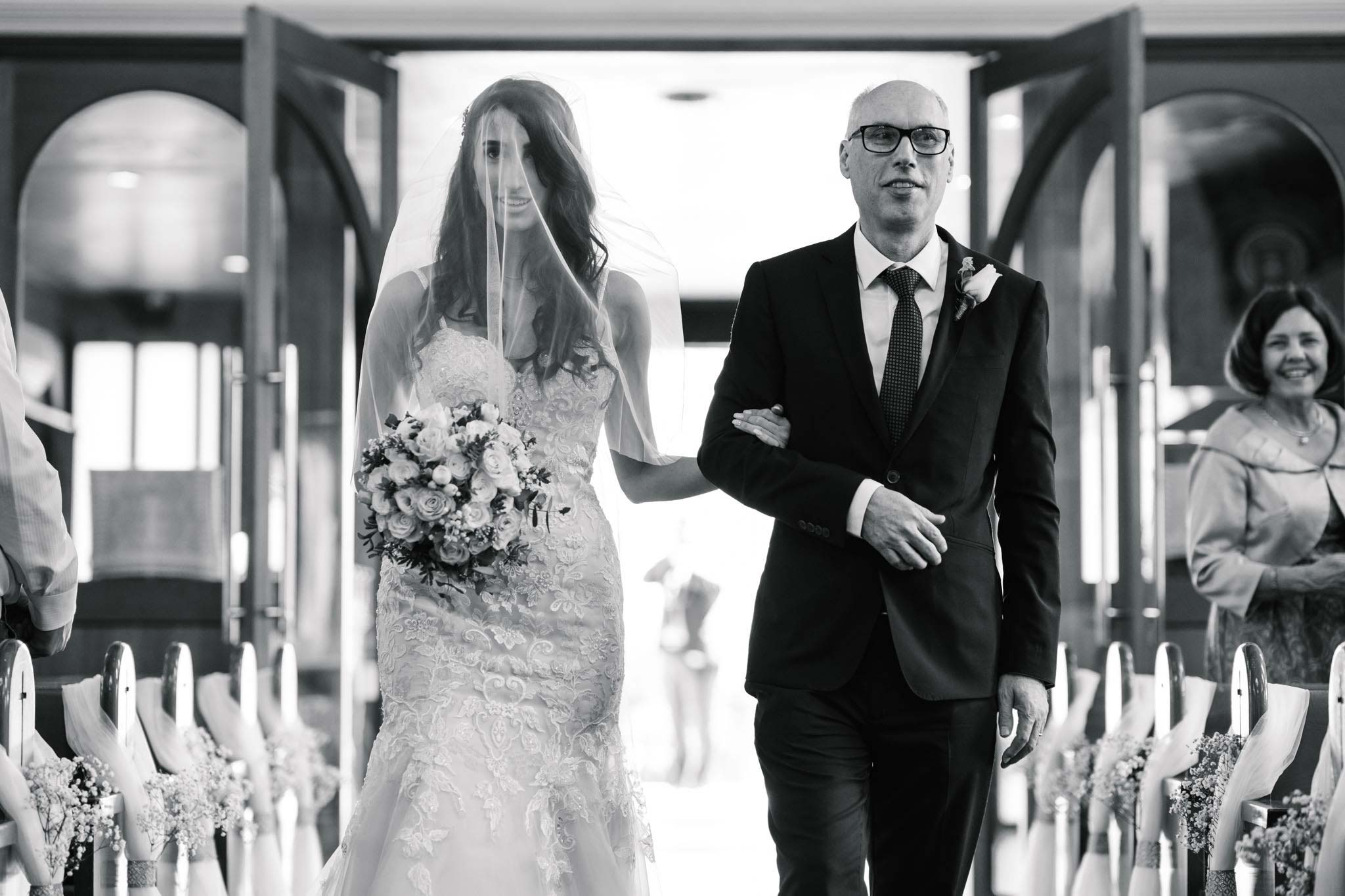 Bride and father walk down the aisle at Sydney Greek orthodox wedding