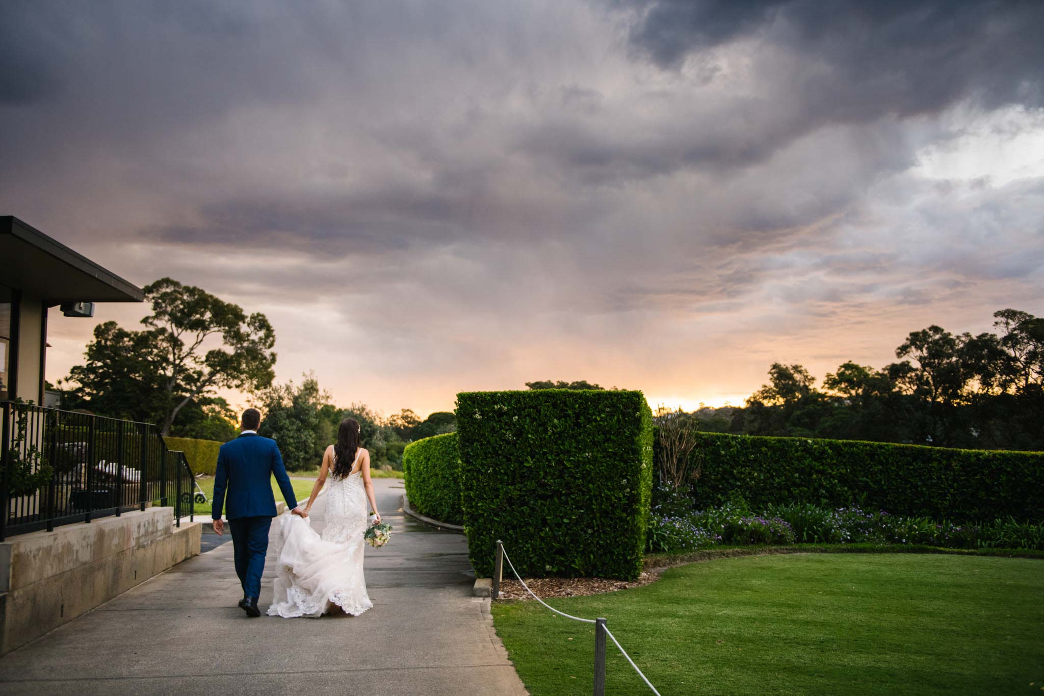 Beautiful sunset clouds above couple at Manly Golf Club