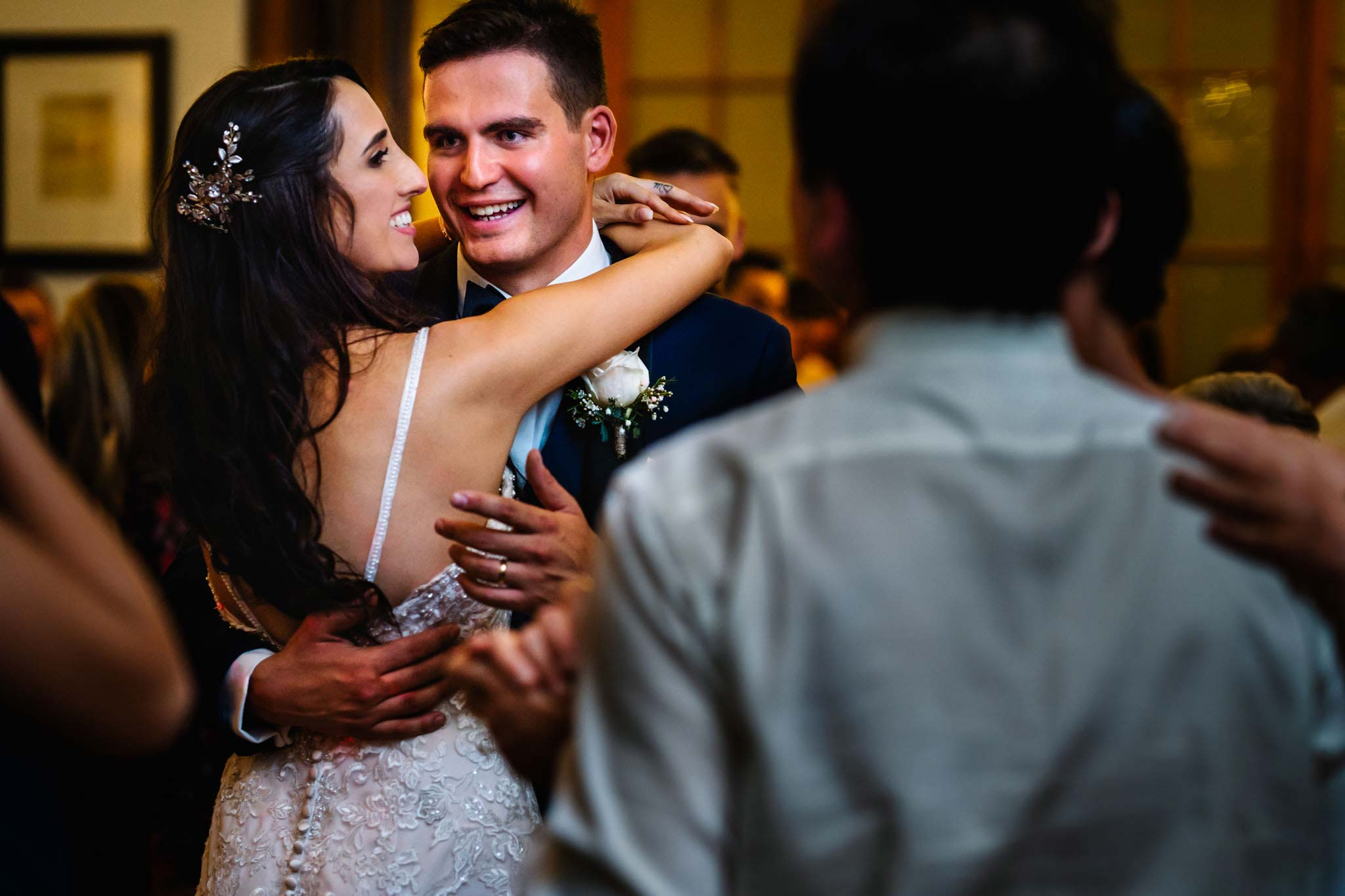 Newlyweds laugh during dance at wedding reception