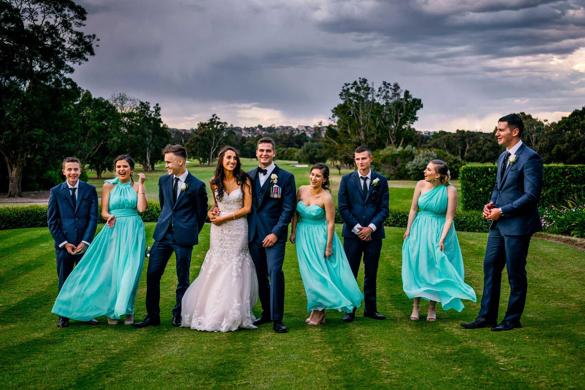 Bridal party having fun at Manly Golf Club wedding reception