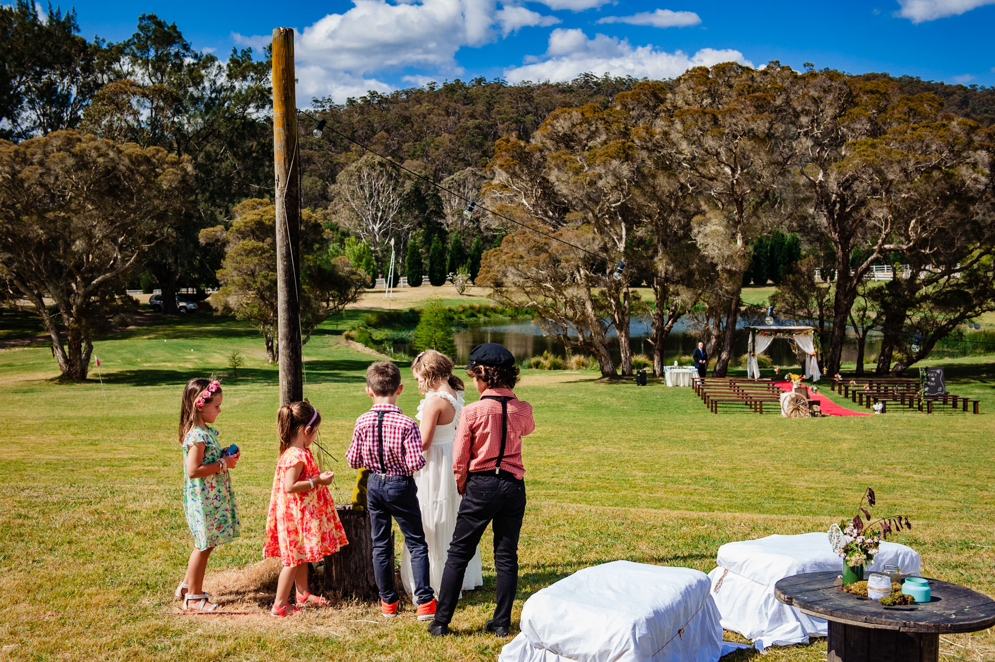 Kids waiting for wedding ceremony to begin at Redwood park Wollombi