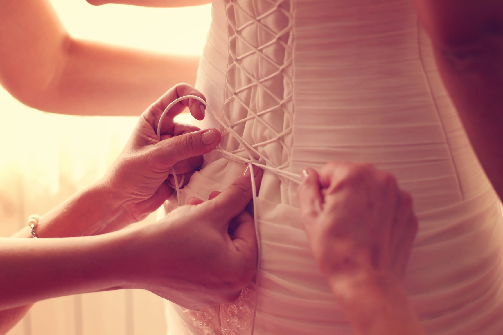 photodune-11751328-hands-helping-the-bride-with-her-wedding-dress-m.jpg