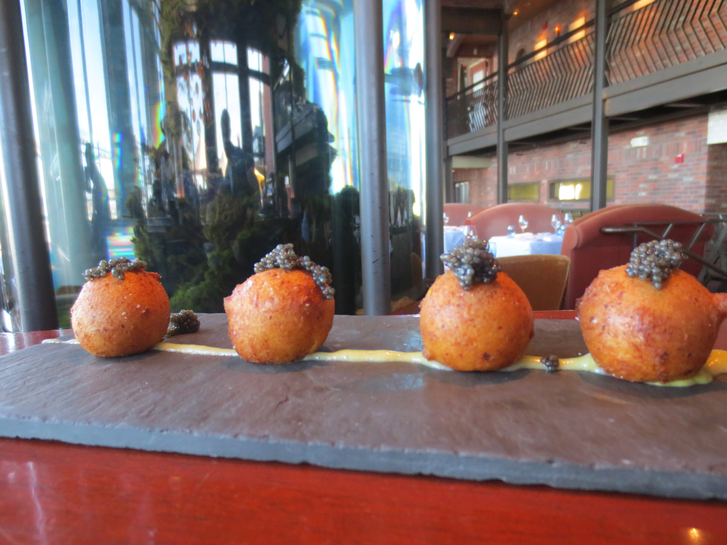 The one and only Ricotta Doughnuts topped with American Caviar