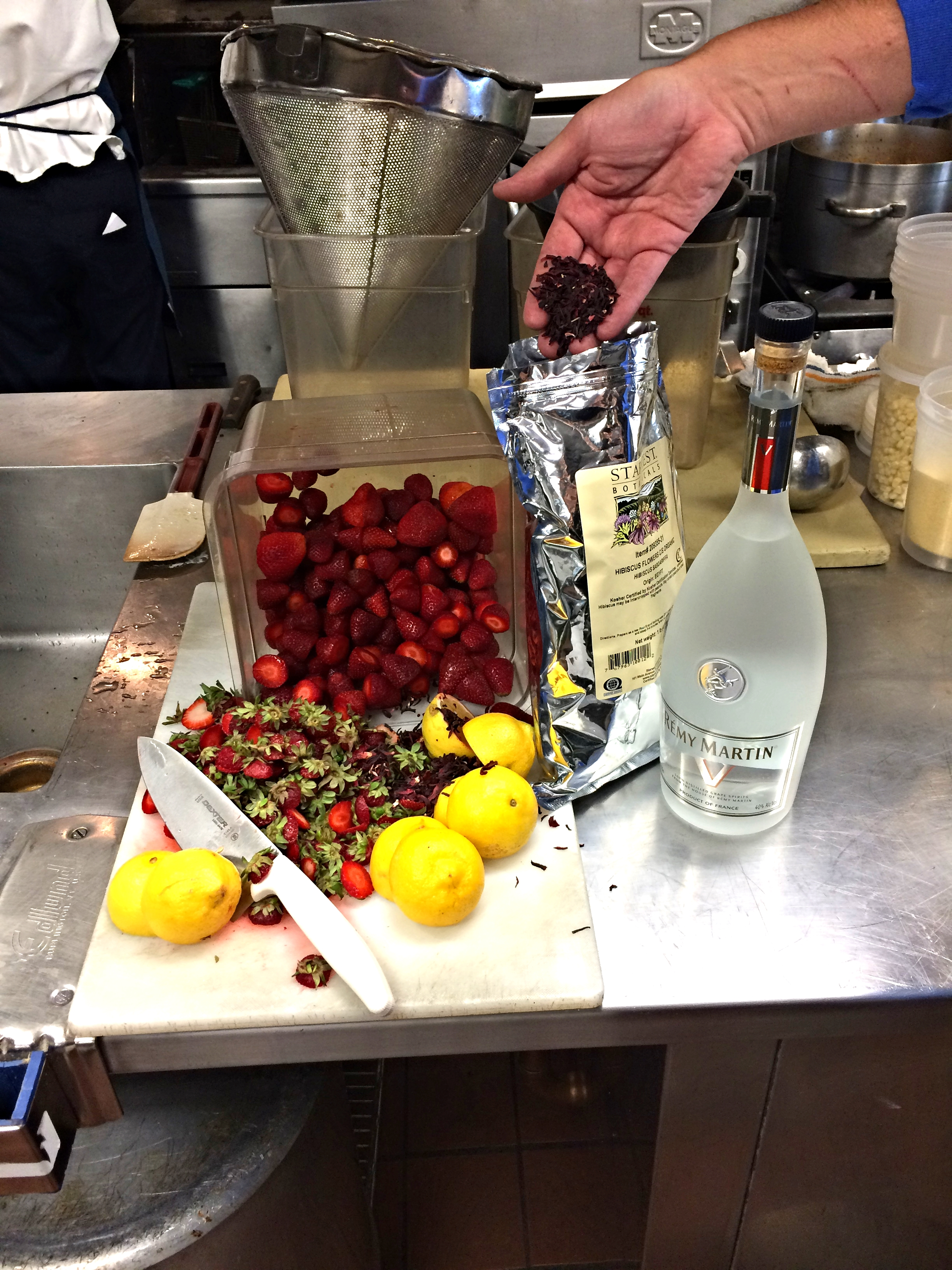 Ingredients for Joe's Strawberry &Hibiscus tincture: strawberries, lemon, Rémy Martin V and dried hibiscus.