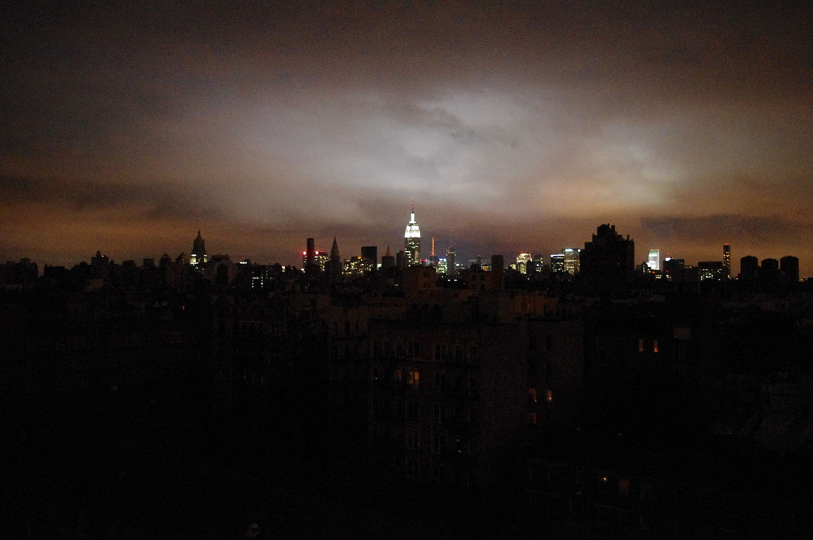 "Image:  David Shankbone . ""New York skyline when half the city was in blackout due to a power failure during Hurricane Sandy. Midtown, with the Empire State Building, is in the background with the darkened East Village and other parts of downtown in the foreground."" Wikimedia"