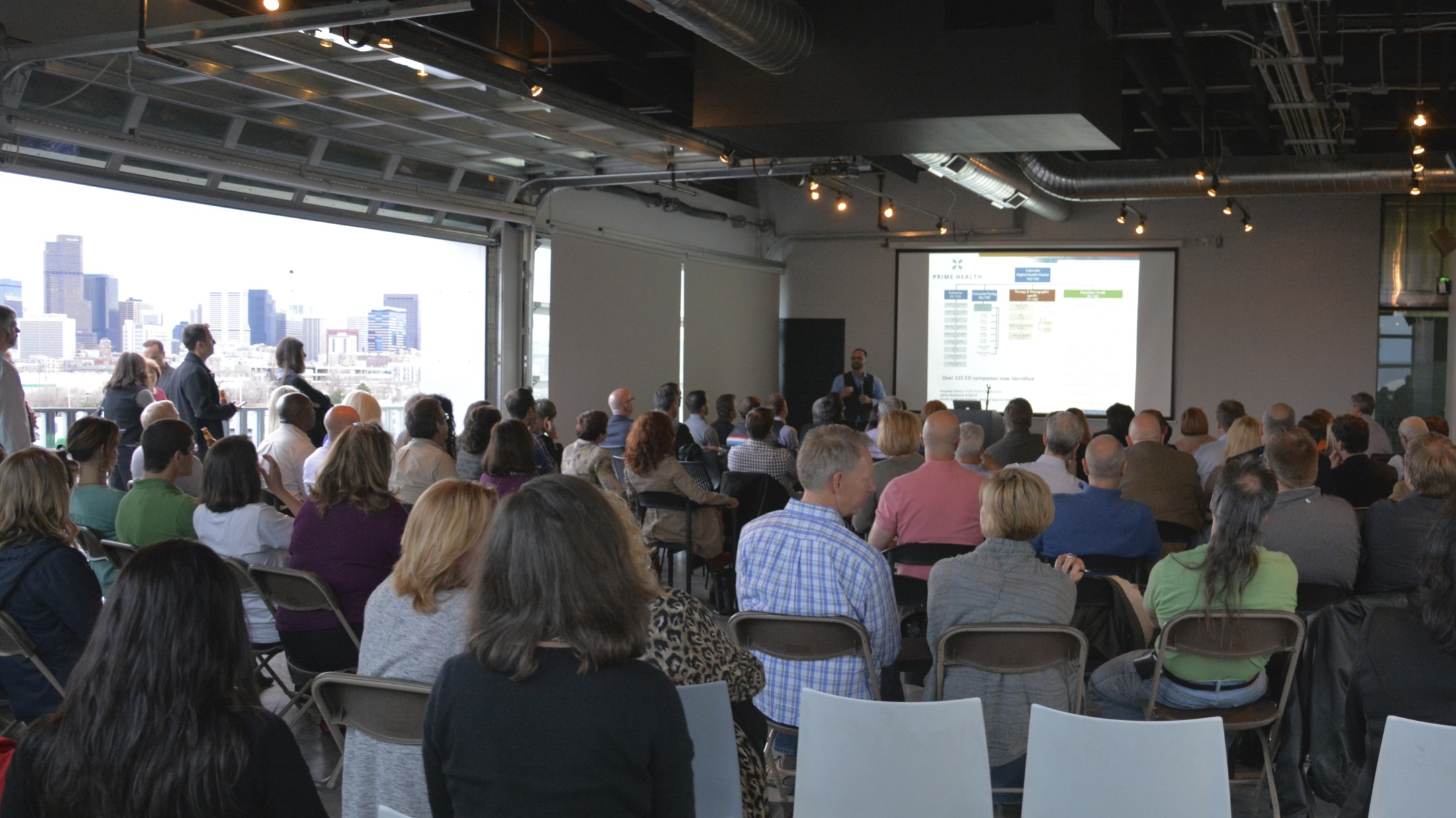 With the Denver skyline in the background, Mike Biselli pushes the digital health vision forward at the March 2015Prime Health Meetup at Taxi.