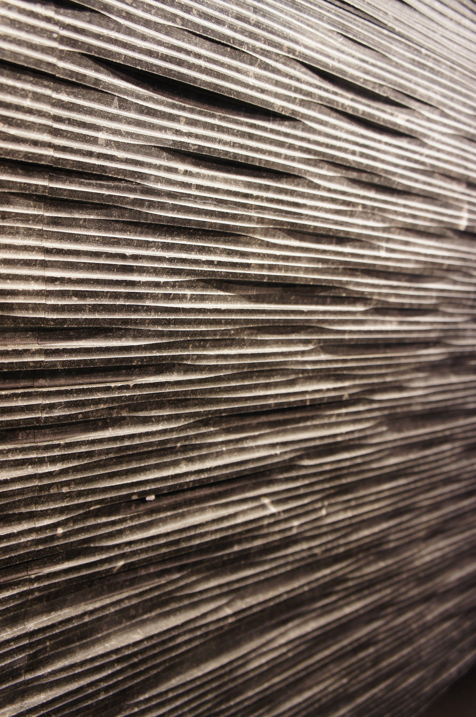 Basket-weave type pattern. Notice the light and dark contrast from the grooves.Hedonism collection by  Petra Antiqua
