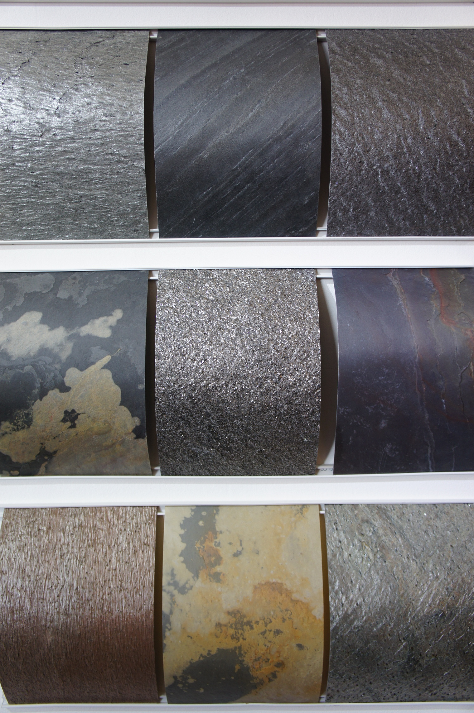 2mm stone veneers made by applying chemicals to different stones, making them pliable enough to strip off thin layers. Each sample shown here is the natural color of the stone, not painted. They are flexible just like wood veneers. The sales rep said their stone veneer is used by Bentley, however the Bentley website only mentioned a Mulliner brand.Flexi-Stone collection by  Mountskape