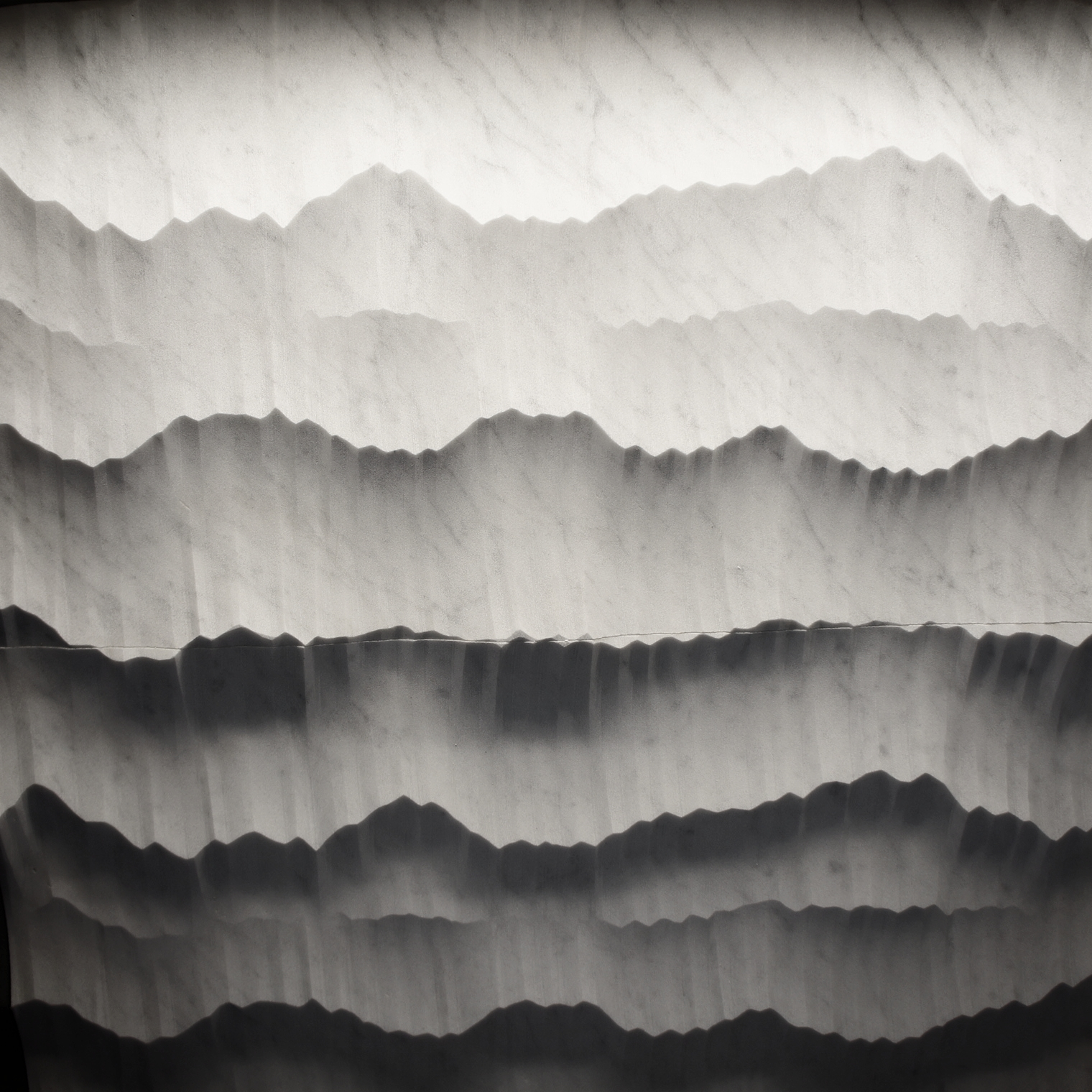Machined, but random texture creates shadows that reveal a mountain landscape.Hedonism collection by  Petra Antiqua